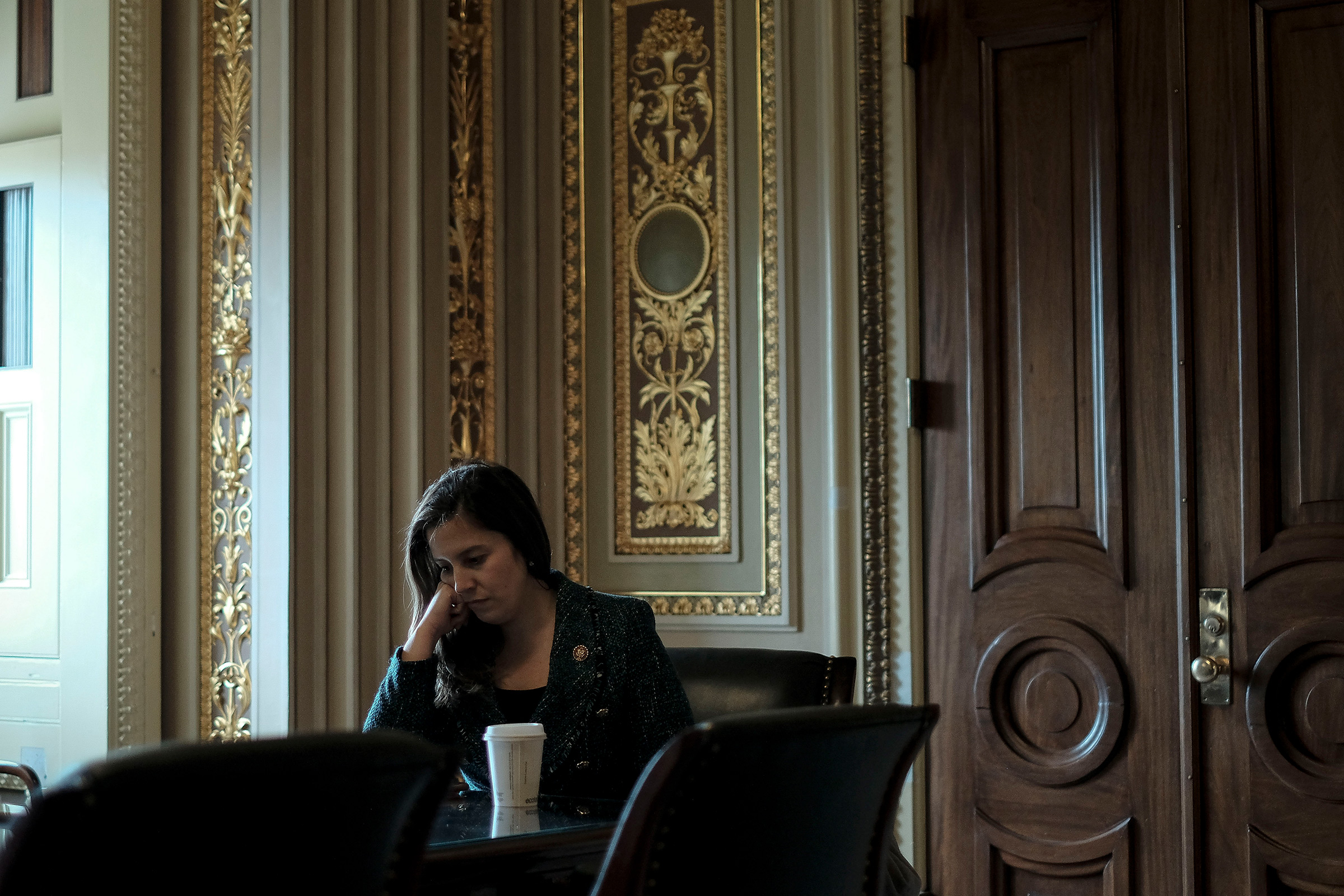 Rep. Elise Stefanik (R-N.Y.), an advisor to Trump's defense team, sits with her staffers outside the defense team meeting room before the impeachment trial at the Capitol in Washington, D.C., on Jan. 24, 2020.