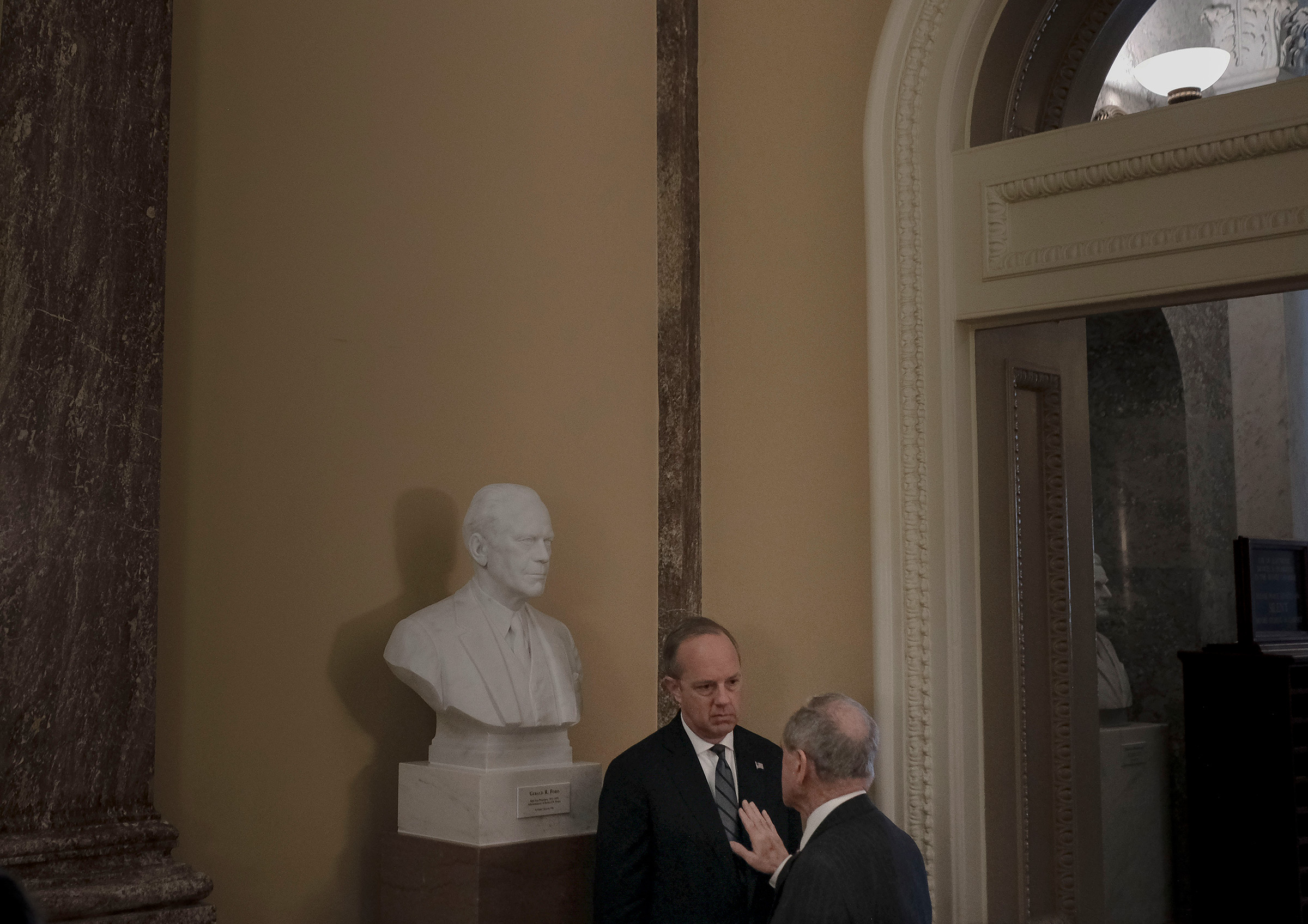 Sen. Jim Risch (R-Idaho) has a private conversation with White House legislative affairs director Eric Ueland off the floor of the senate before the impeachment trial at the Capitol in Washington, D.C., on Jan. 24, 2020.
