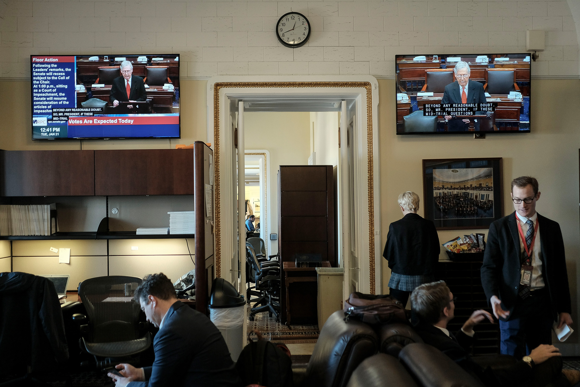 Reporters watch the senate impeachment trial begin in the press gallery off the senate floor at the Capitol in Washington, D.C. on Jan. 21, 2020.
