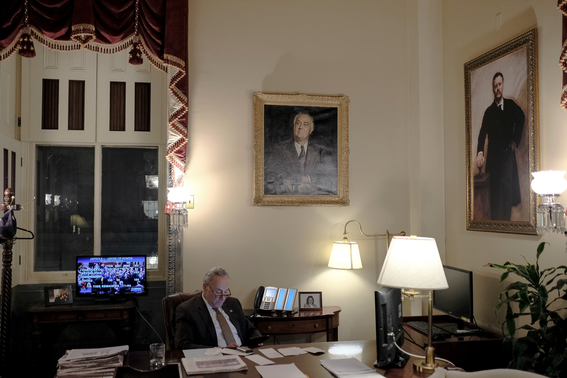 Senate Minority Leader Chuck Schumer (D-N.Y.) watches the House vote on the articles of impeachment in his office at the Capitol in Washington, D.C., on Dec. 18, 2019.