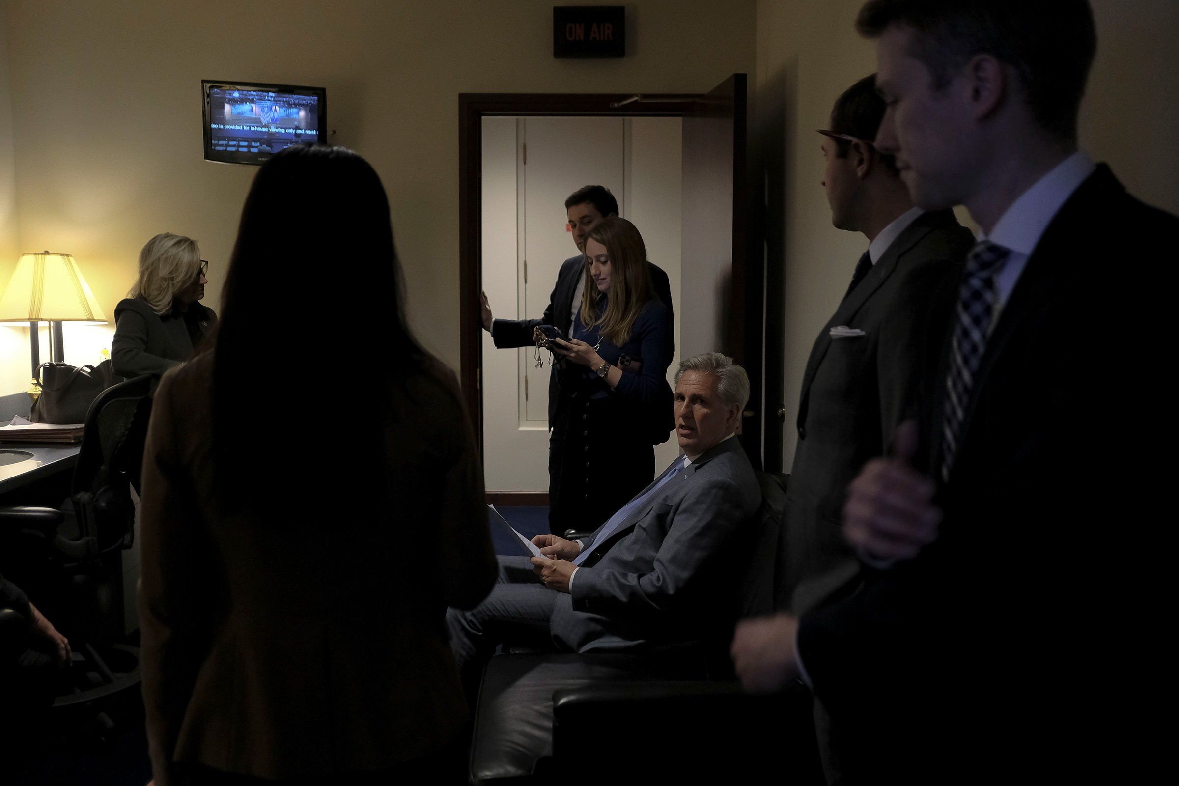 House Minority Leader Kevin McCarthy (R-Calif.) reads over his notes with other GOP leaders before a press conference denouncing the vote on the articles of impeachment at the Capitol in Washington, D.C., on Dec. 17, 2019.