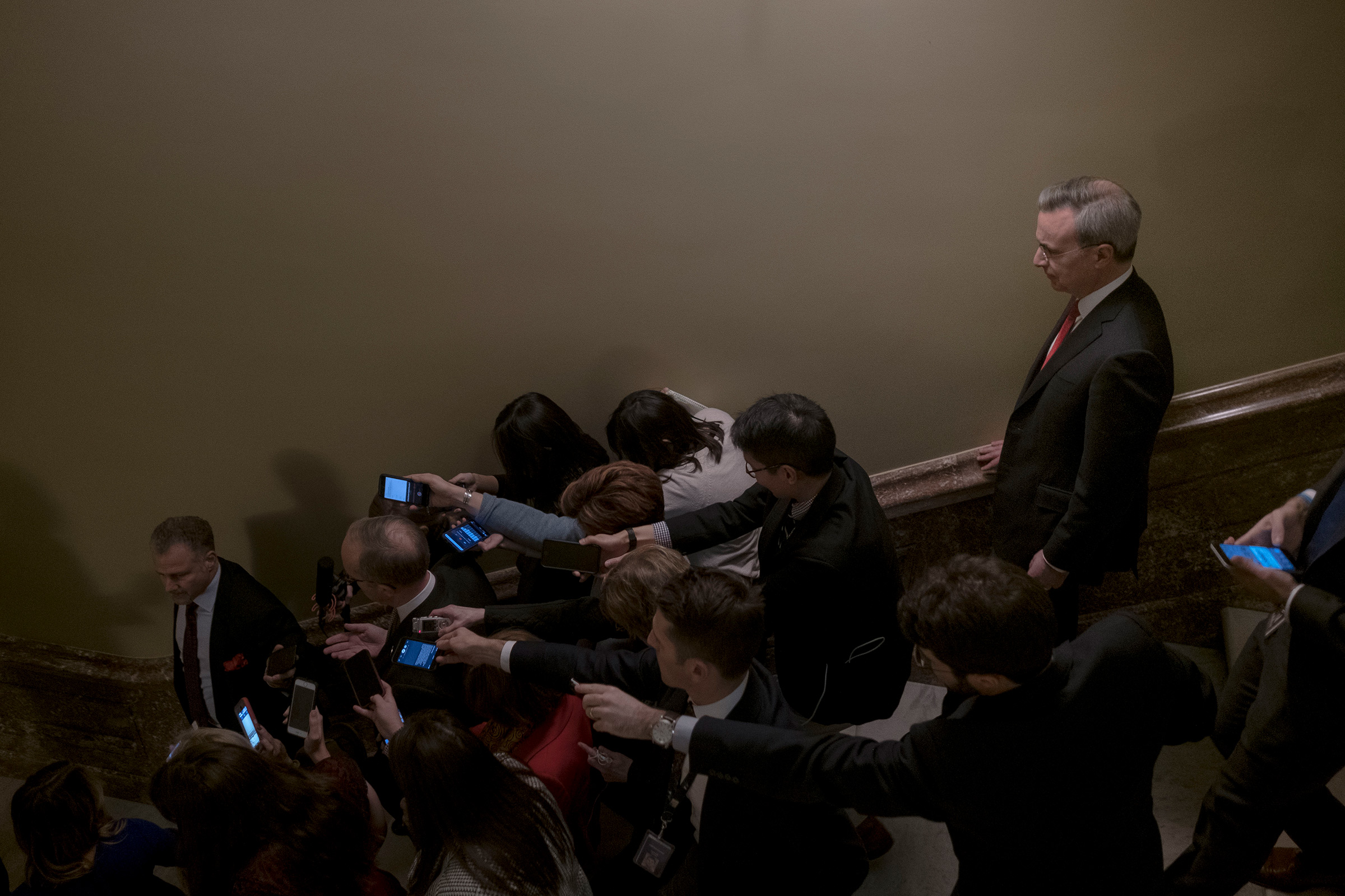 White House lawyer Pat Cipollone keeps his distance as Eric Ueland, Director of White House Legislative Affairs, speaks to reporters after a meeting with Senate Majority Leader Mitch McConnell (R-Ky) at the Capitol in Washington, D.C., on Dec. 12, 2019.