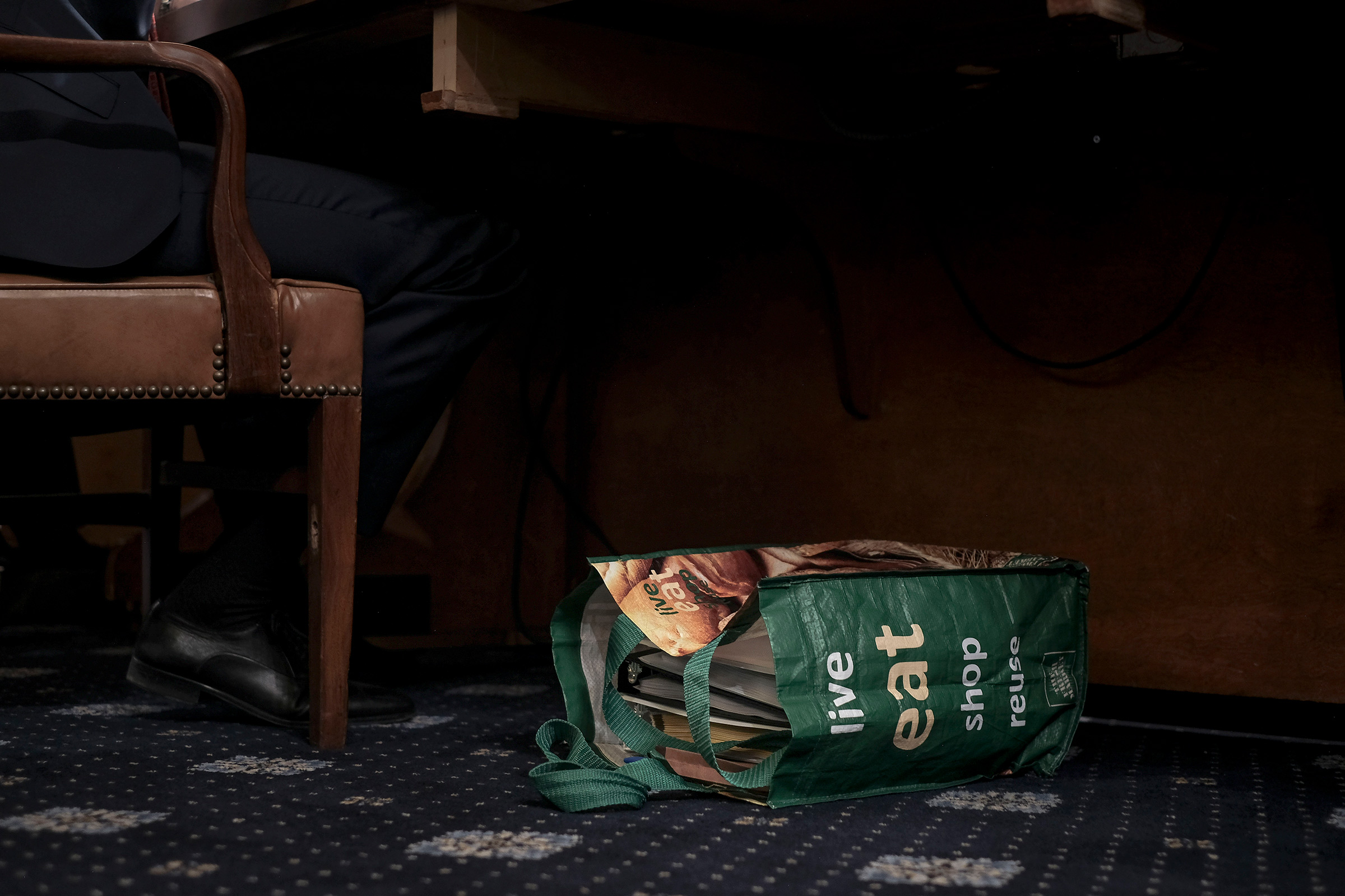 A reusable shopping bag filled with documents and notes sit at the feet of Stephen Castor, the Republican counsel to the Judiciary and Intelligence committee, at the beginning of the House Judiciary Committee hearing on the impeachment inquiry in Washington, D.C., on Dec. 9, 2019.