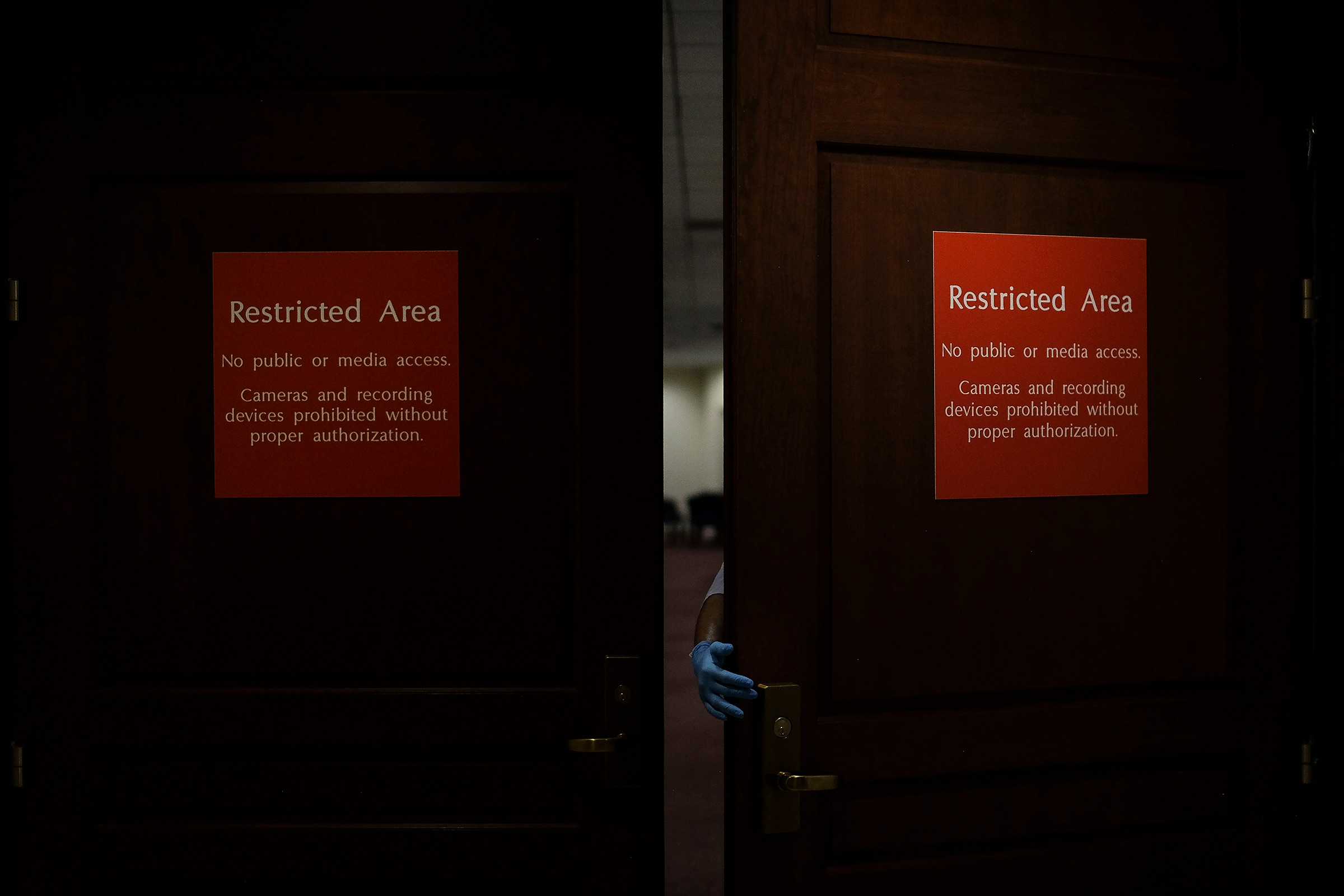 A custodial staff member walks into the sensitive compartmented information facility (SCIF), where Democrats conducted closed-door depositions during the House impeachment inquiry, in the basement of the Capitol in Washington, D.C., on Oct. 1, 2019.