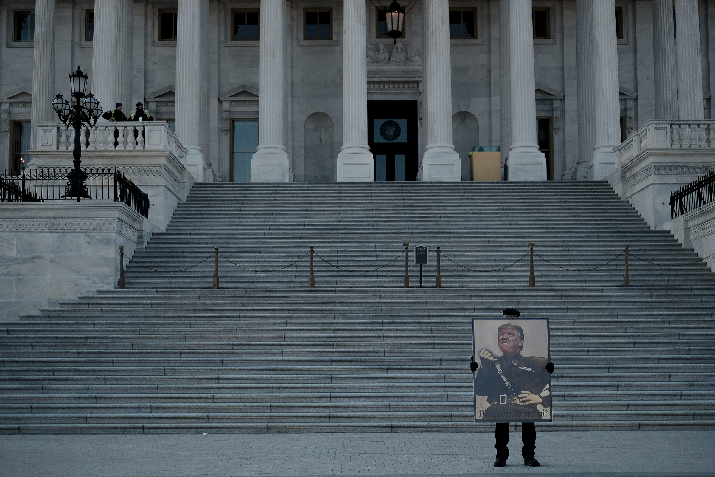 A protestor demonstrates against President Donald Trump in front of the Capitol during the senate impeachment trial in Washington, D.C., on Jan. 29, 2020.
