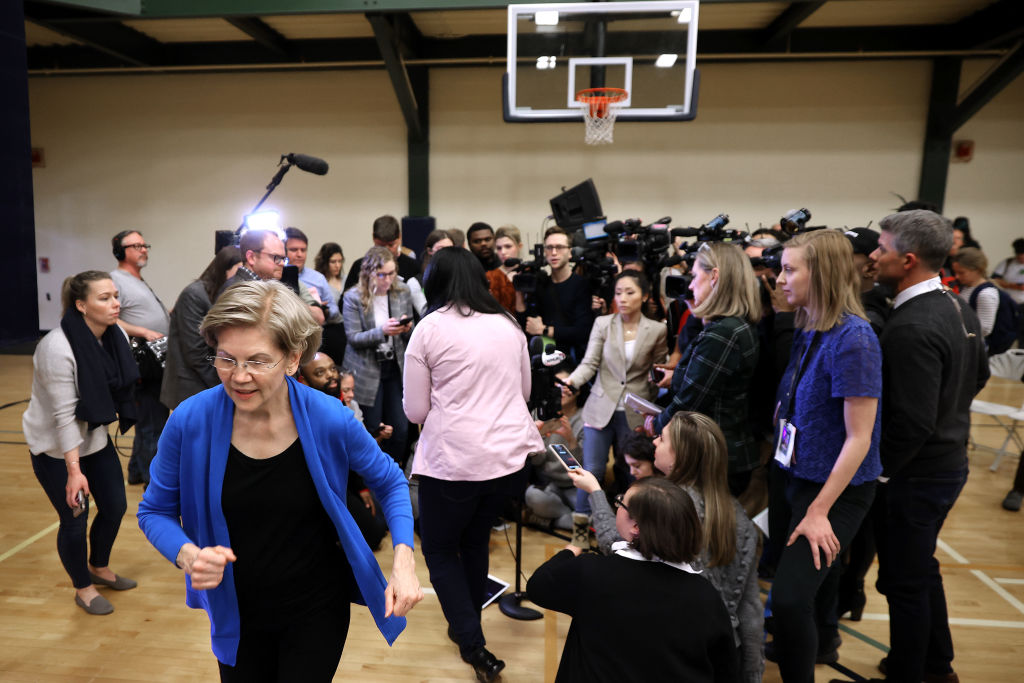 Democratic presidential candidate Sen. Elizabeth Warren jogs away after talking to repoters during a campaign event at Nashua Community College on February 5, 2020 in Nashua, NH.