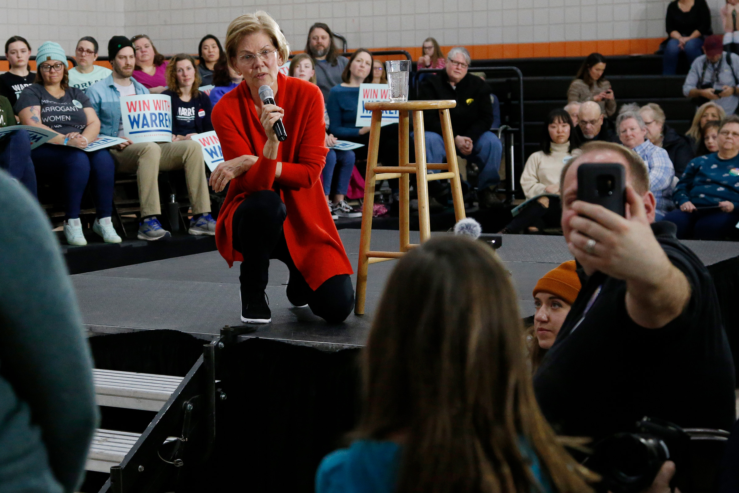 Democratic presidential candidate Sen. Elizabeth Warren, answers a question for a young girl during a town hall in Davenport, Iowa, Jan. 26, 2020.