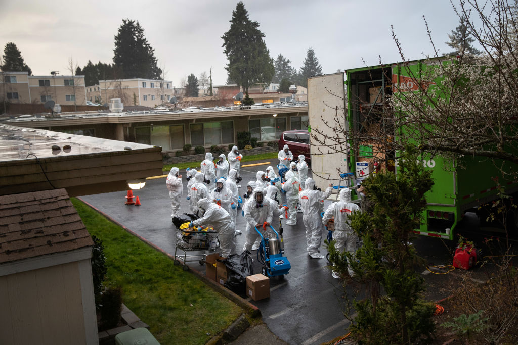 A cleaning crew suits up in protective clothing before entering the Life Care Center on March 12, 2020 in Kirkland, Washington.
