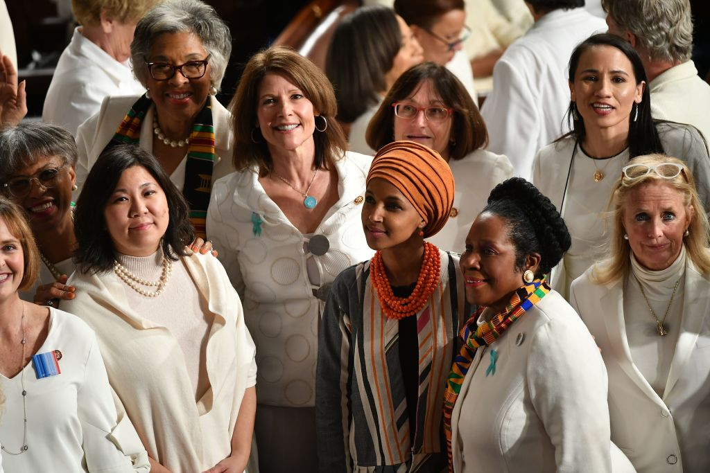 Representative from Minnesota Ilhan Omar and Democratic members from the House of Representatives wearing white attend the State Of The Union address at the US Capitol in Washington, DC, on Feb. 4, 2020.