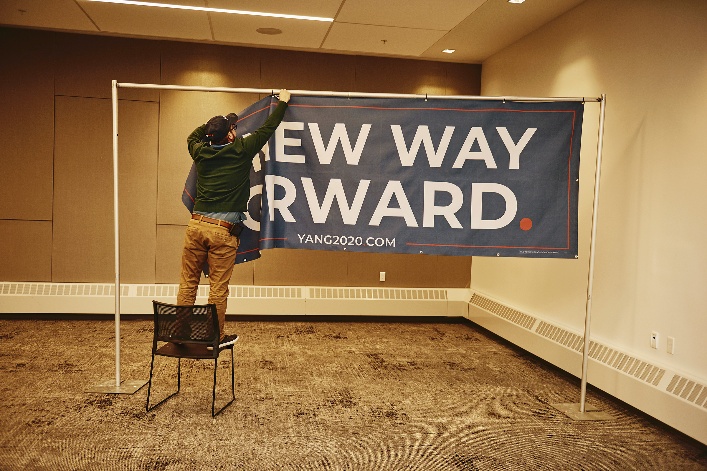 A worker packs up a banner for Andrew Yang's campaign at the Merrill Place Conference Center at Plymouth State University in Plymouth, N.H. on Feb. 6, 2020.