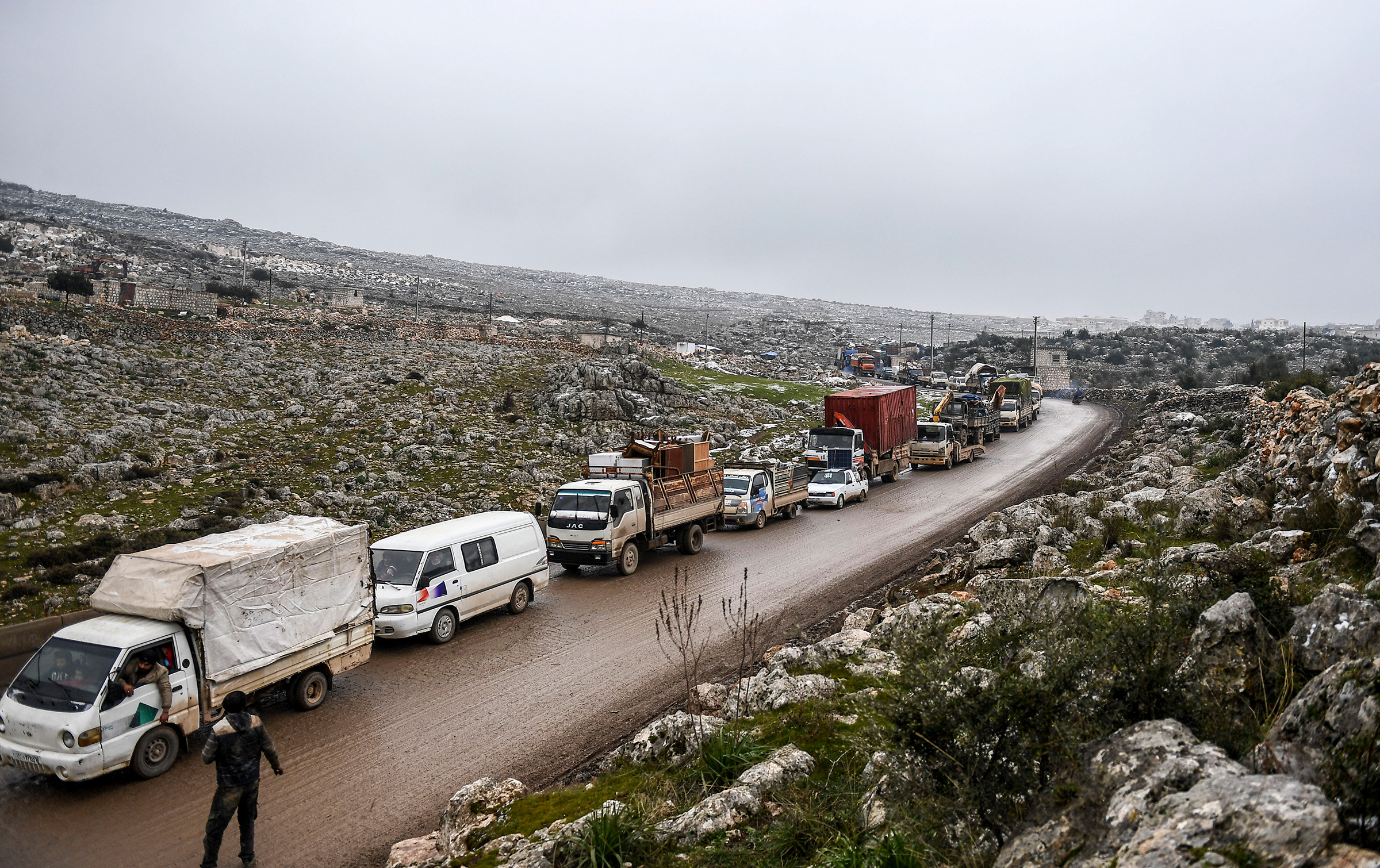 Syrian civilians flee Idlib on Feb. 13