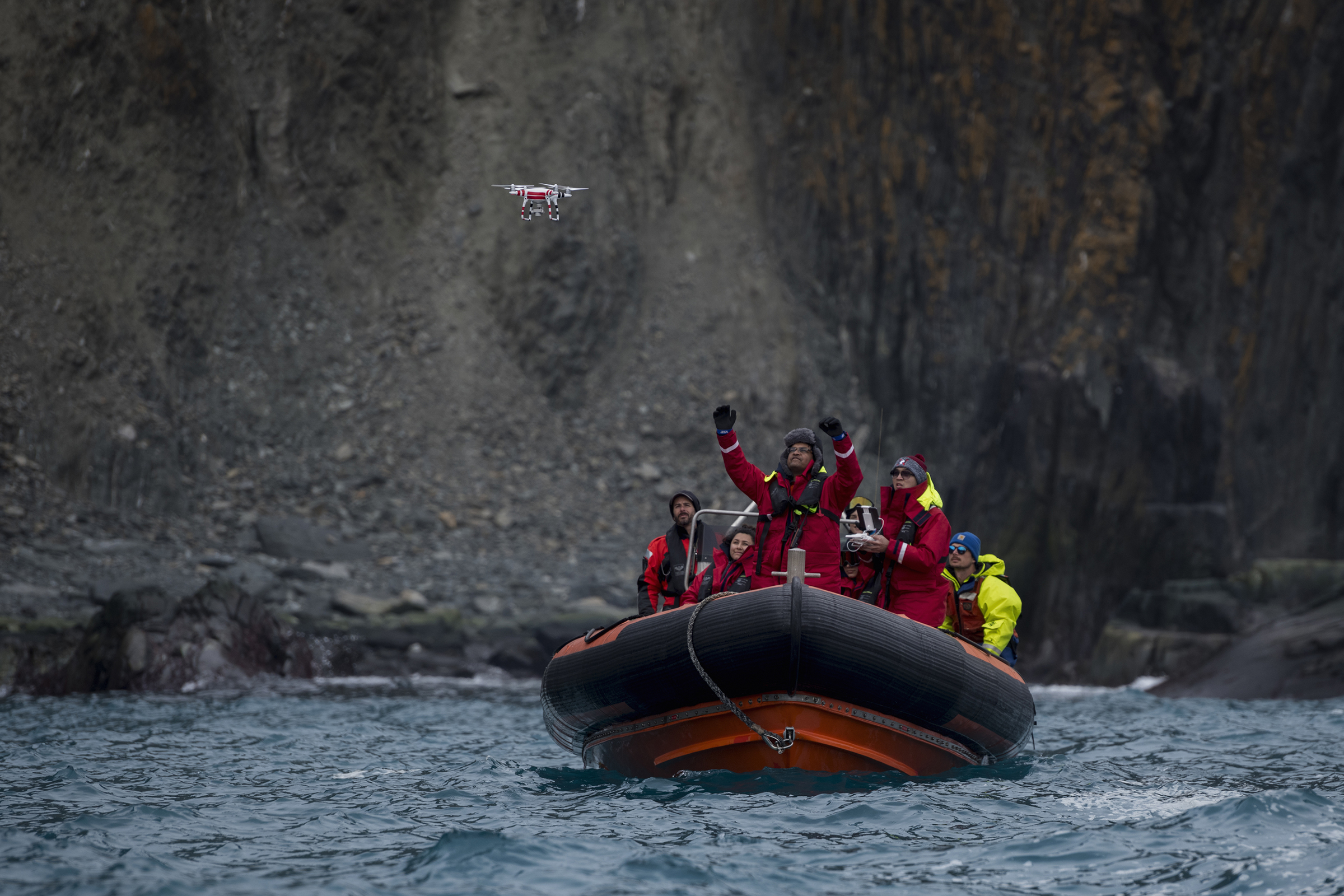 Yang Liu and Vikrant Shah, from North Eastern University, launch a drone from a Greenpeace inflatable. They will later use machine learning to do an automated count of penguin colonies on Elephant Island. The drone counts are later compared to the manual counts done by another team of scientists.