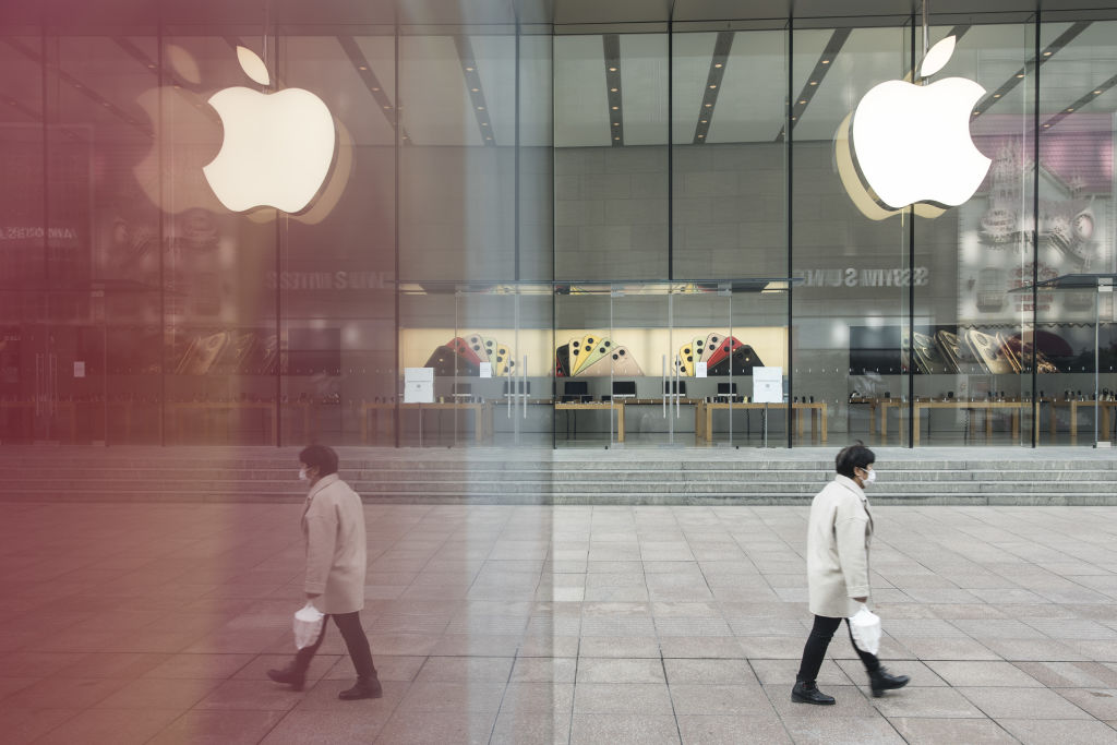 A pedestrian wearing a protective mask walks past a closed Apple Inc. store in Shanghai, China, on Wednesday, Feb. 5, 2020.