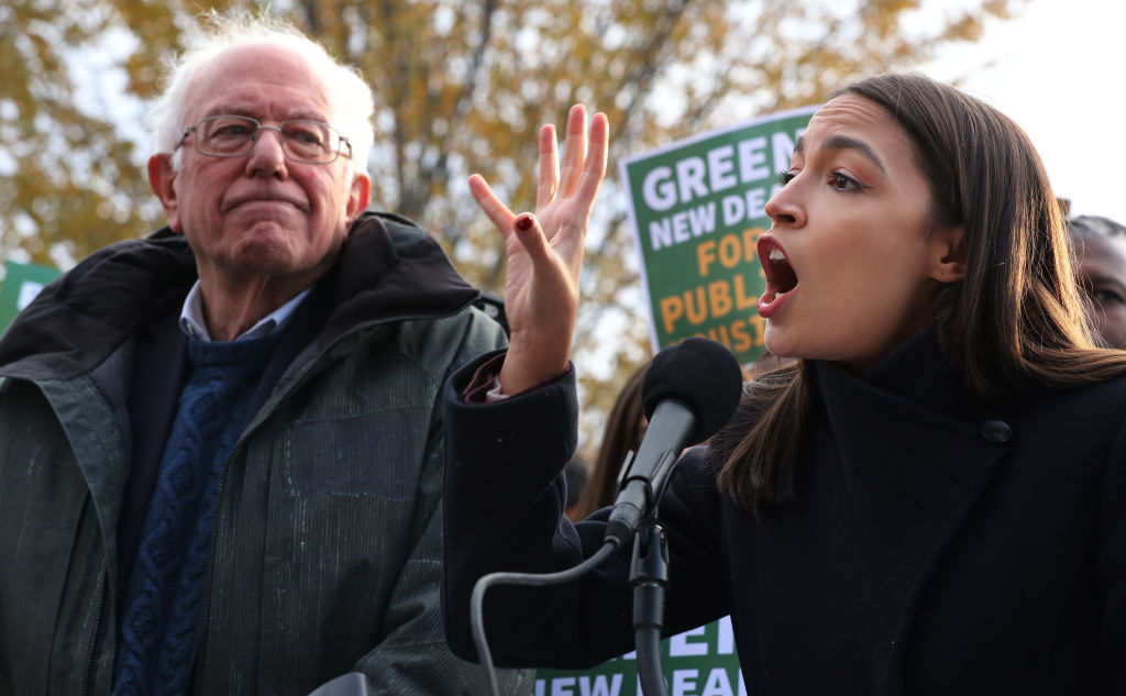 Bernie Sanders and Alexandria Ocasio-Cortez introducing legislation to transform public housing as part of their Green New Deal proposal, on Nov. 14, 2019.