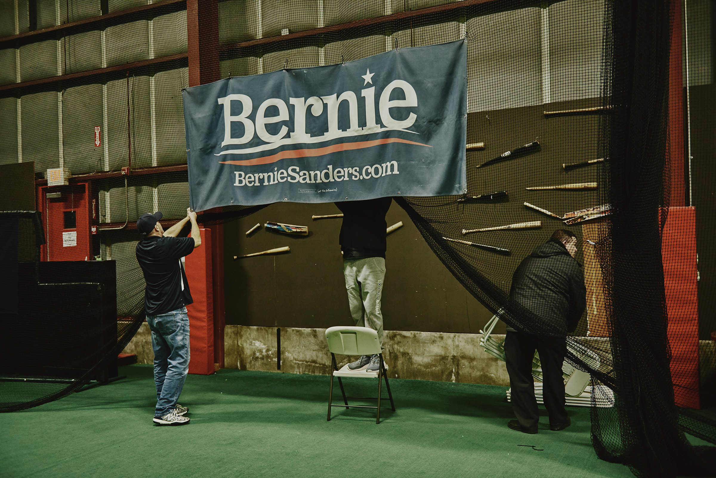 Workers clean up after the Bernie Sanders 2020 Debate Watch Party at the Ultimate Sports Academy in Manchester, N.H. on Feb. 7, 2020.