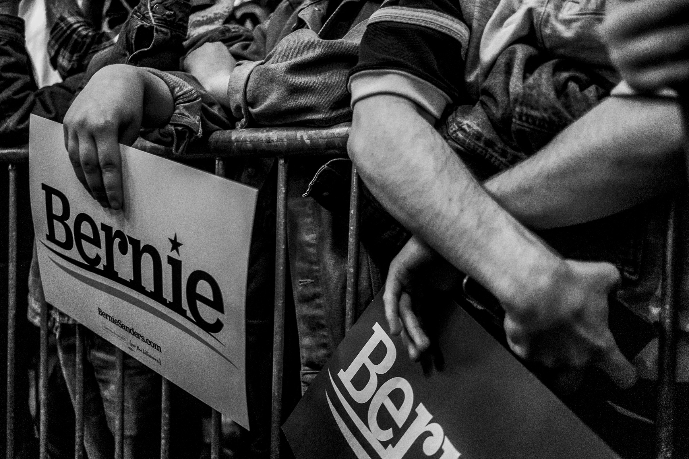 Supports of Sen. Bernie Sanders hold signs during the Bernie Caucus Concert in Cedar Rapids, Iowa.