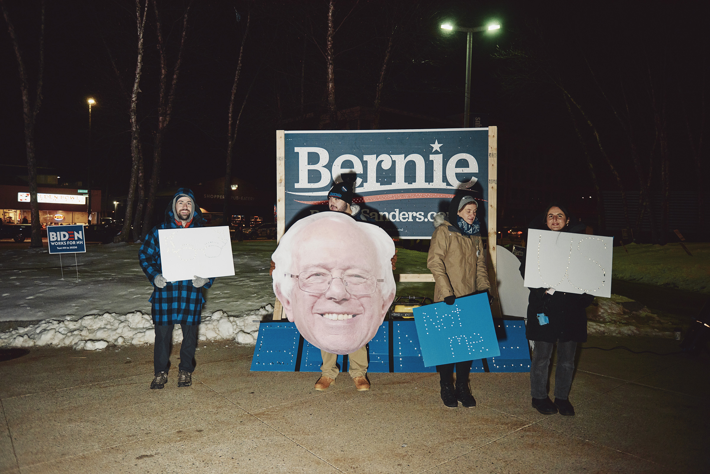 Bernie Sanders supporters outside of the New Hampshire Democratic Party's McIntyre-Shaheen 100 Club Event in Manchester, N.H. on Feb. 8, 2020.