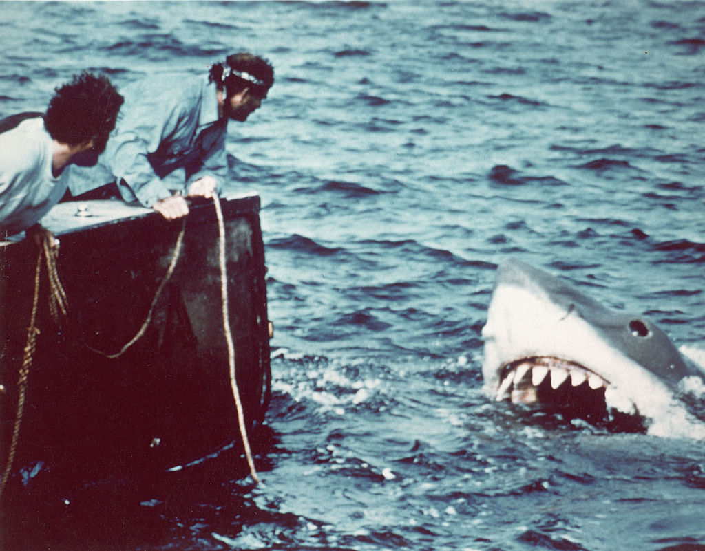 Actor Richard Dreyfuss (left) (as marine biologist Hooper) and British author and actor Robert Shaw (as shark fisherman Quint) look off the stern of Quint's fishing boat the 'Orca' at the terrifying approach of the mechanical giant shark dubbed 'Bruce' in a scene from the film Jaws.