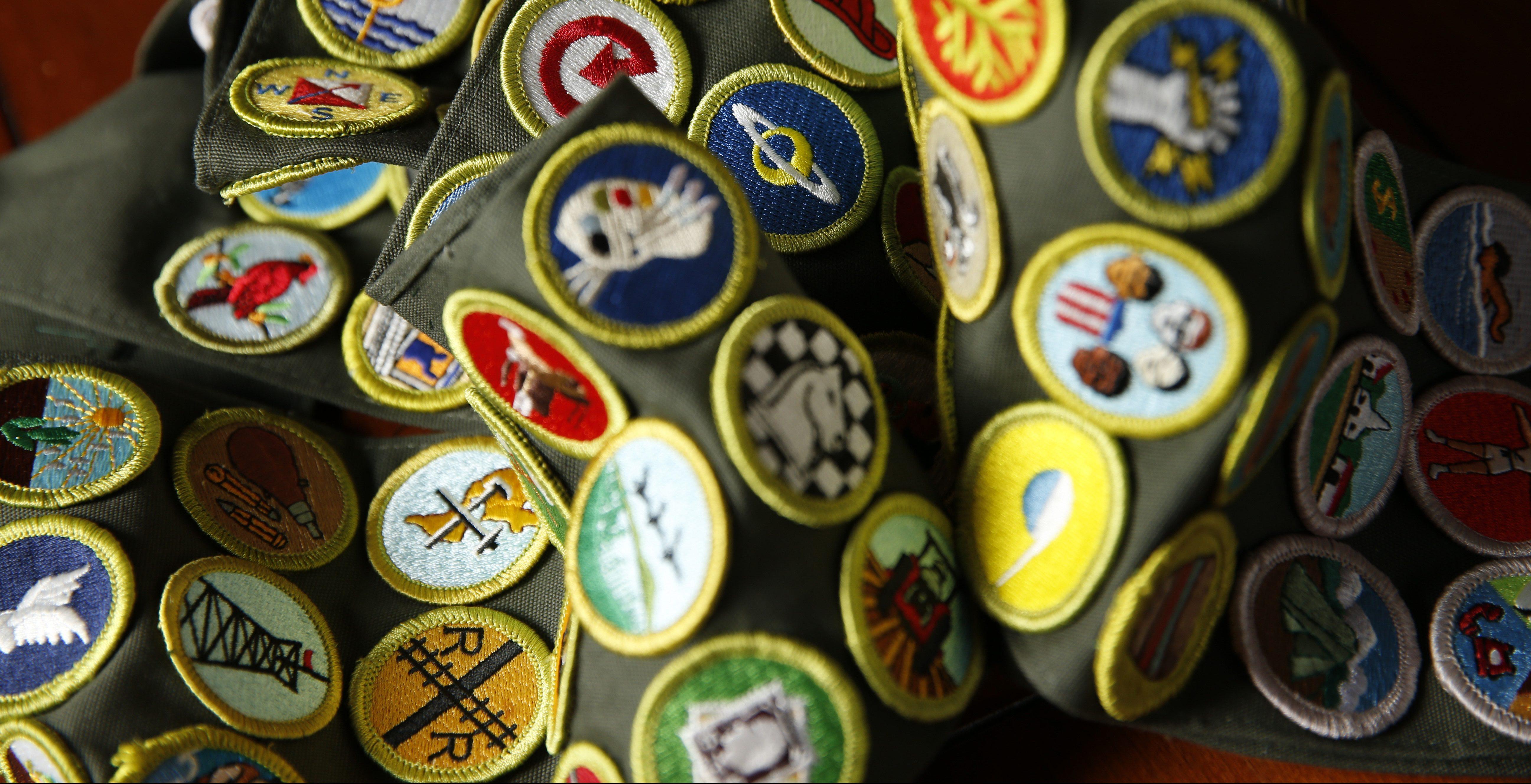 This Nov. 22, 2016, photo, shows a sash of Boy Scout merit badges.