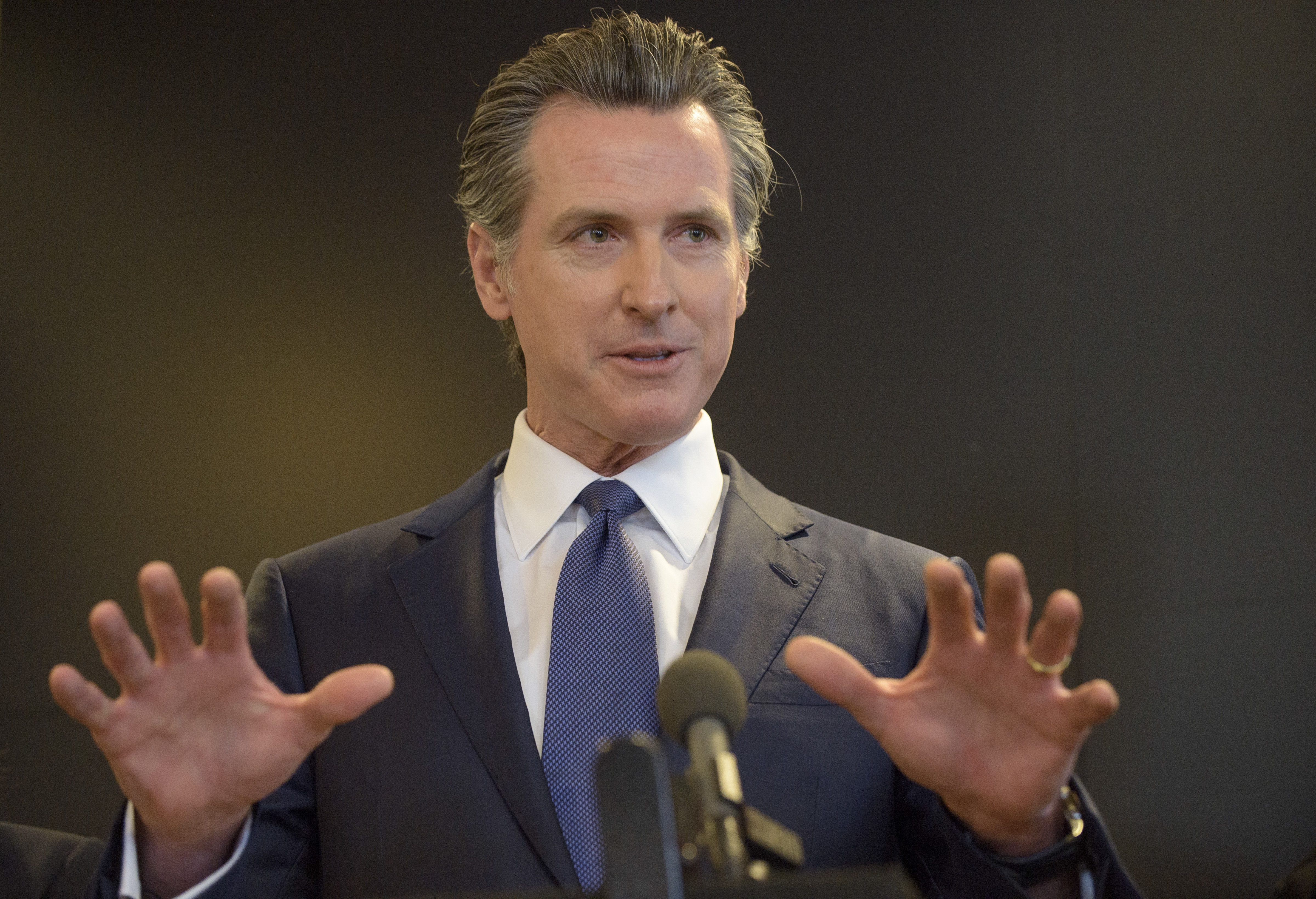 California Governor Gavin Newsom speaks to members of the press at a news conference in Sacramento, Calif., on Feb. 27, 2020.