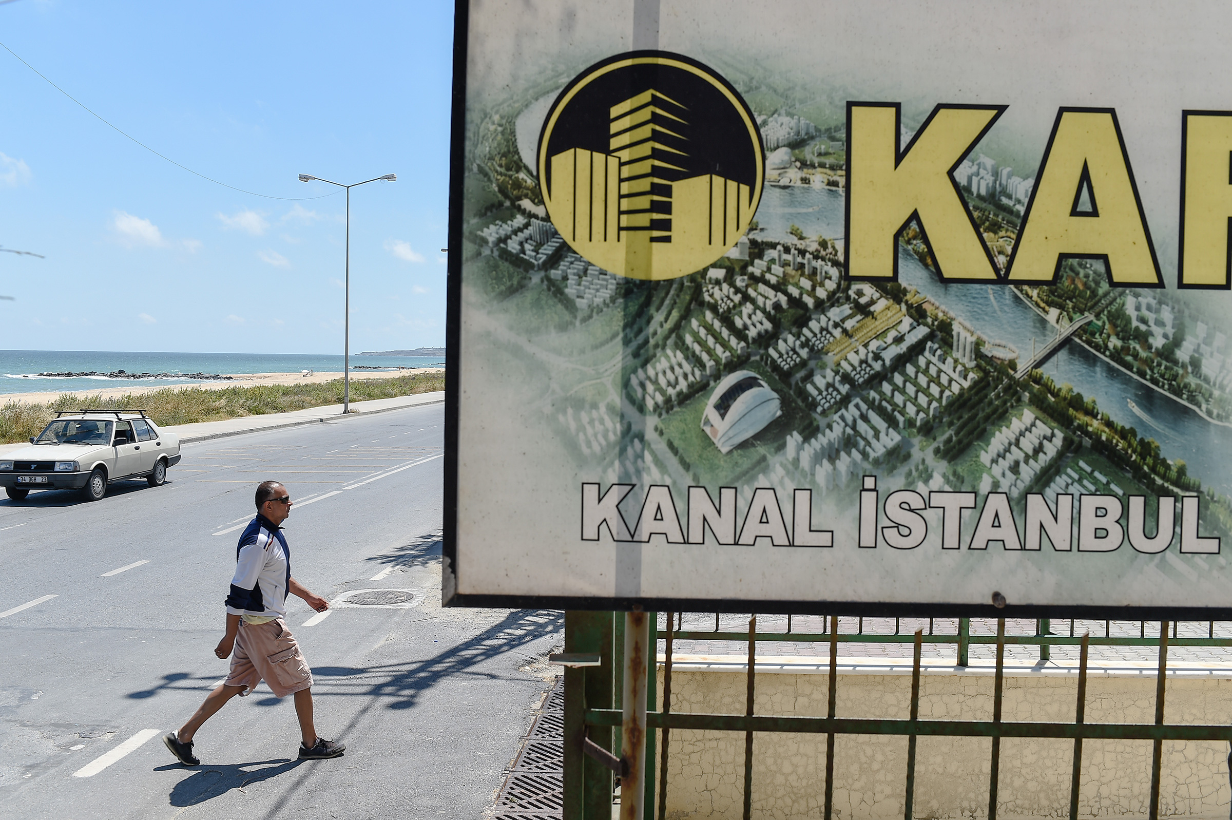 A real estate advertisement offers apartments with a view on the canal in the small coastal village of Karaburun, Turkey, in June 2018.