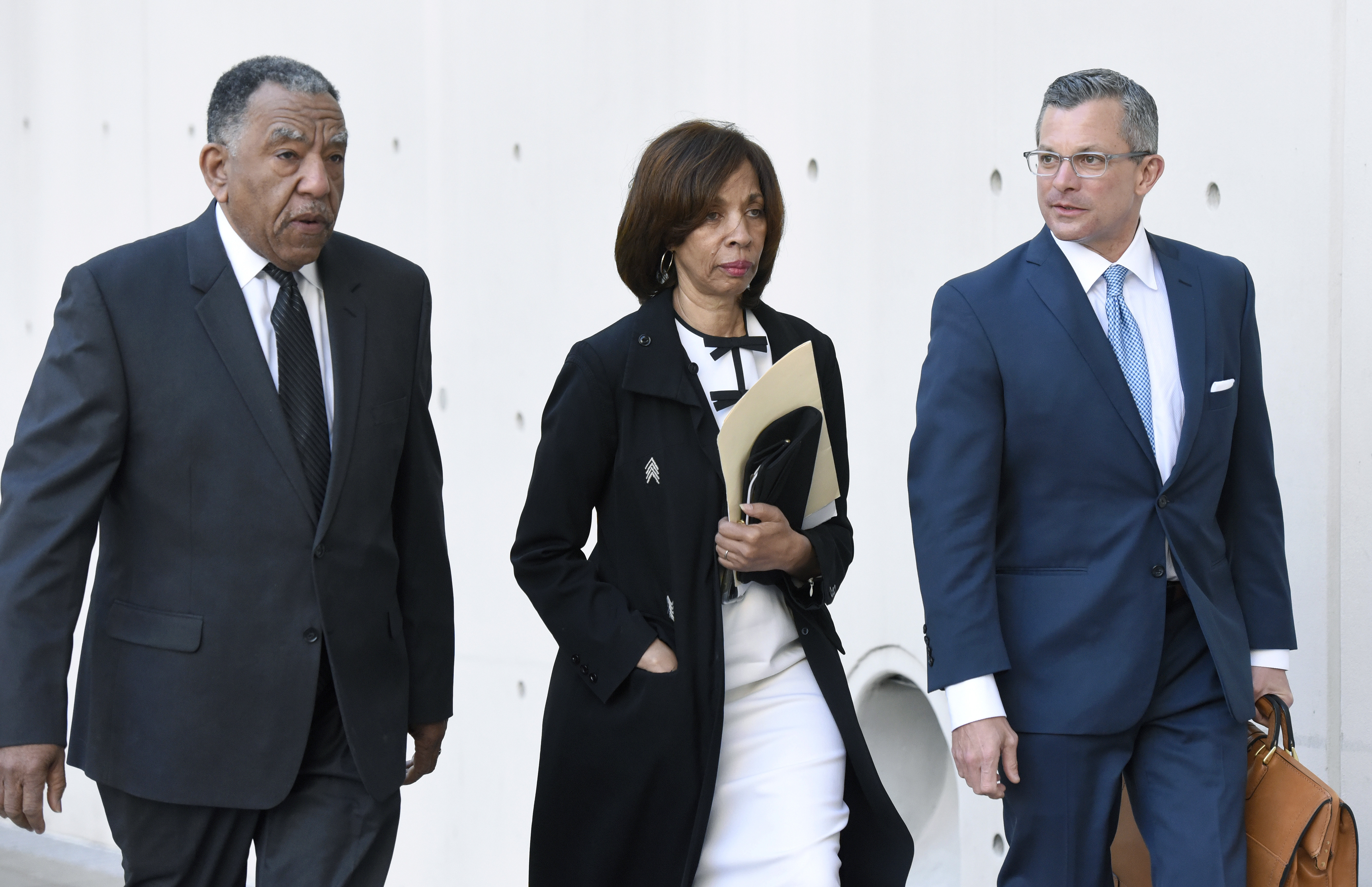 Former Baltimore mayor Catherine Pugh, center, and her attorney Steven Silverman, right, arrive for a sentencing hearing at U.S. District Court in Baltimore on on Feb. 27, 2020.
