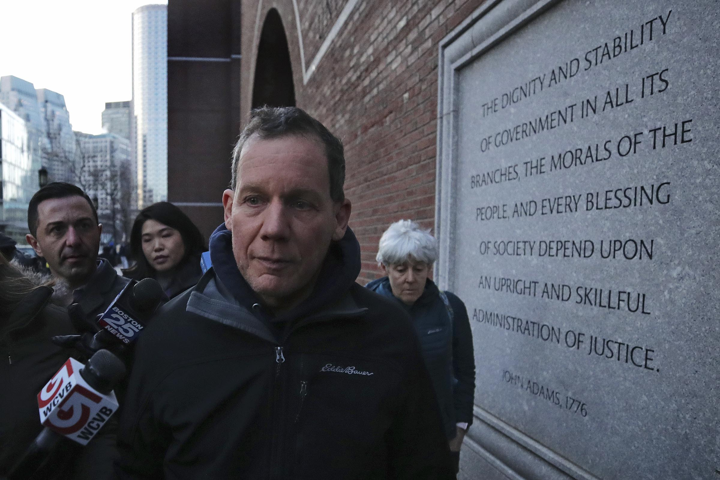 Harvard University professor Charles Lieber leaves the Moakley Federal Courthouse in Boston, on Jan. 30, 2020.