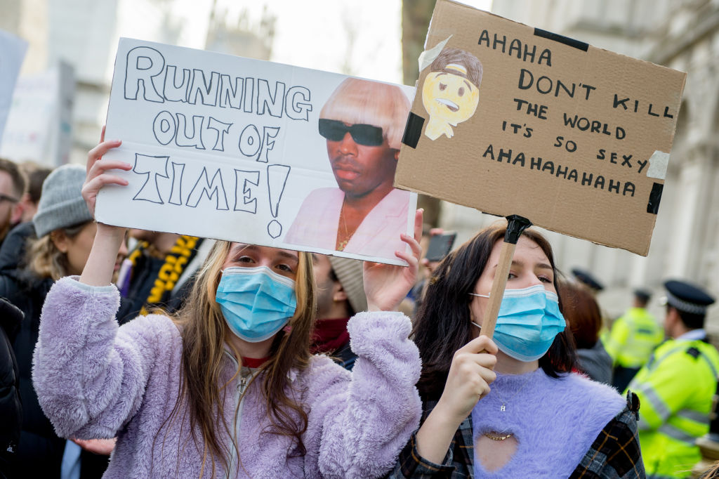 Teenage Climate Crisis activists from various climate activism groups protesting in Westminster during the first UK Students Strike Over Climate Change march of 2020 on February 14, 2020 in London, England.