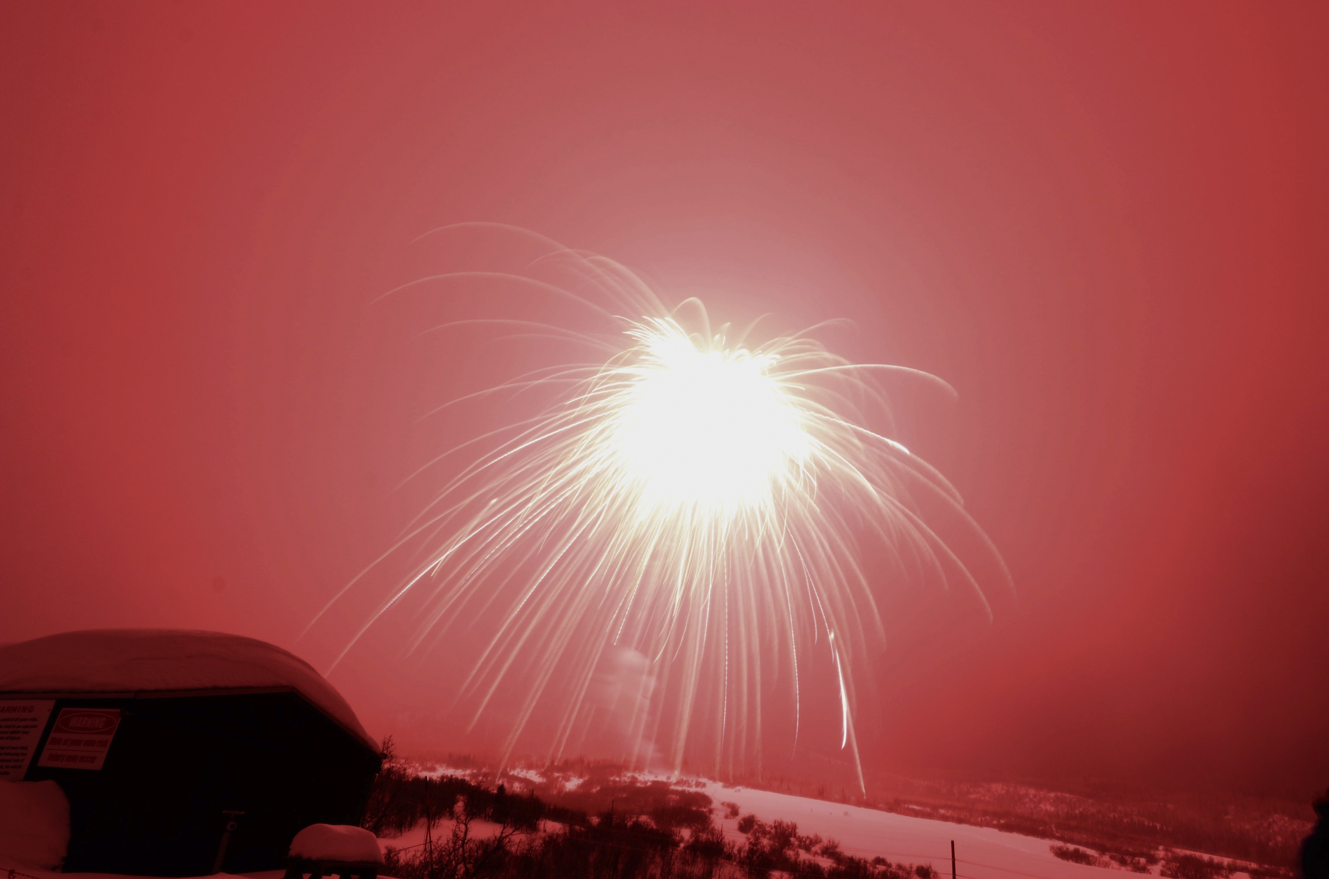 In this Feb. 8, 2020 photo, a firework explodes over Colorado ski resort town Steamboat Springs. The firework has set a record as the world's largest aerial firework.