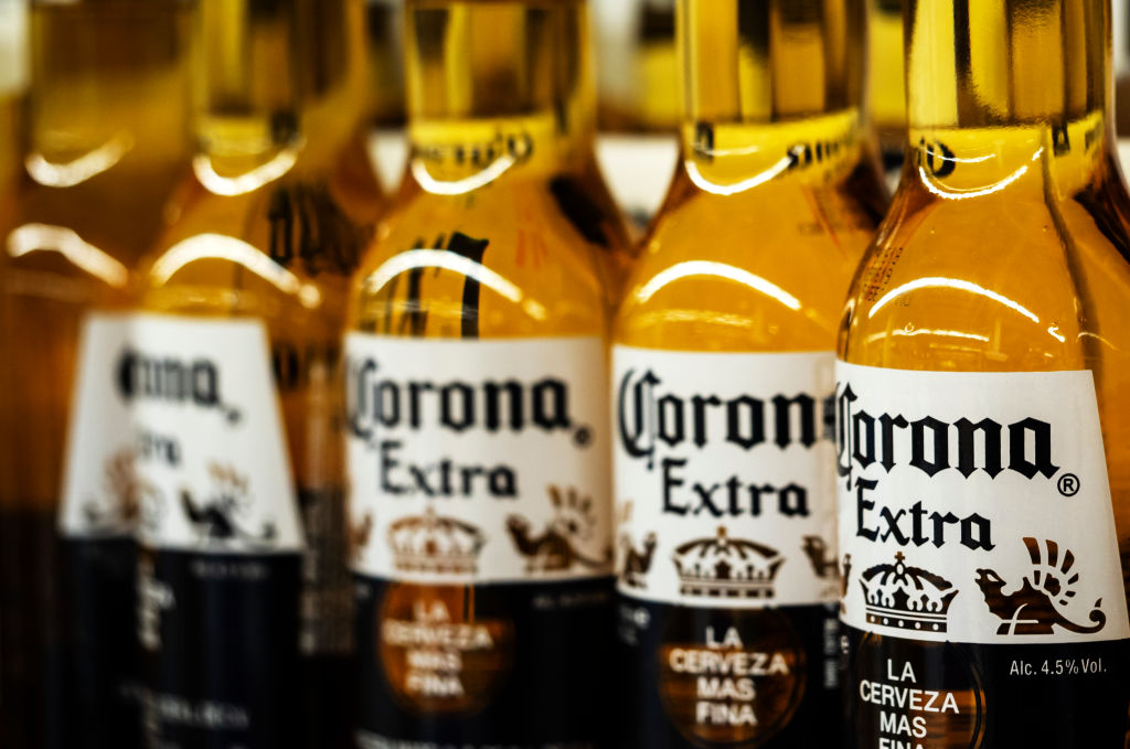 Detail of lined up Corona beer bottles seen on the store shelf. Corona extra Lager Beer is the flagship product of the Mexican company Grupo Modelo.