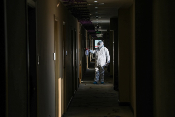 A medical worker disinfects a hotel converted into a quarantine zone in Wuhan, on Feb. 3
