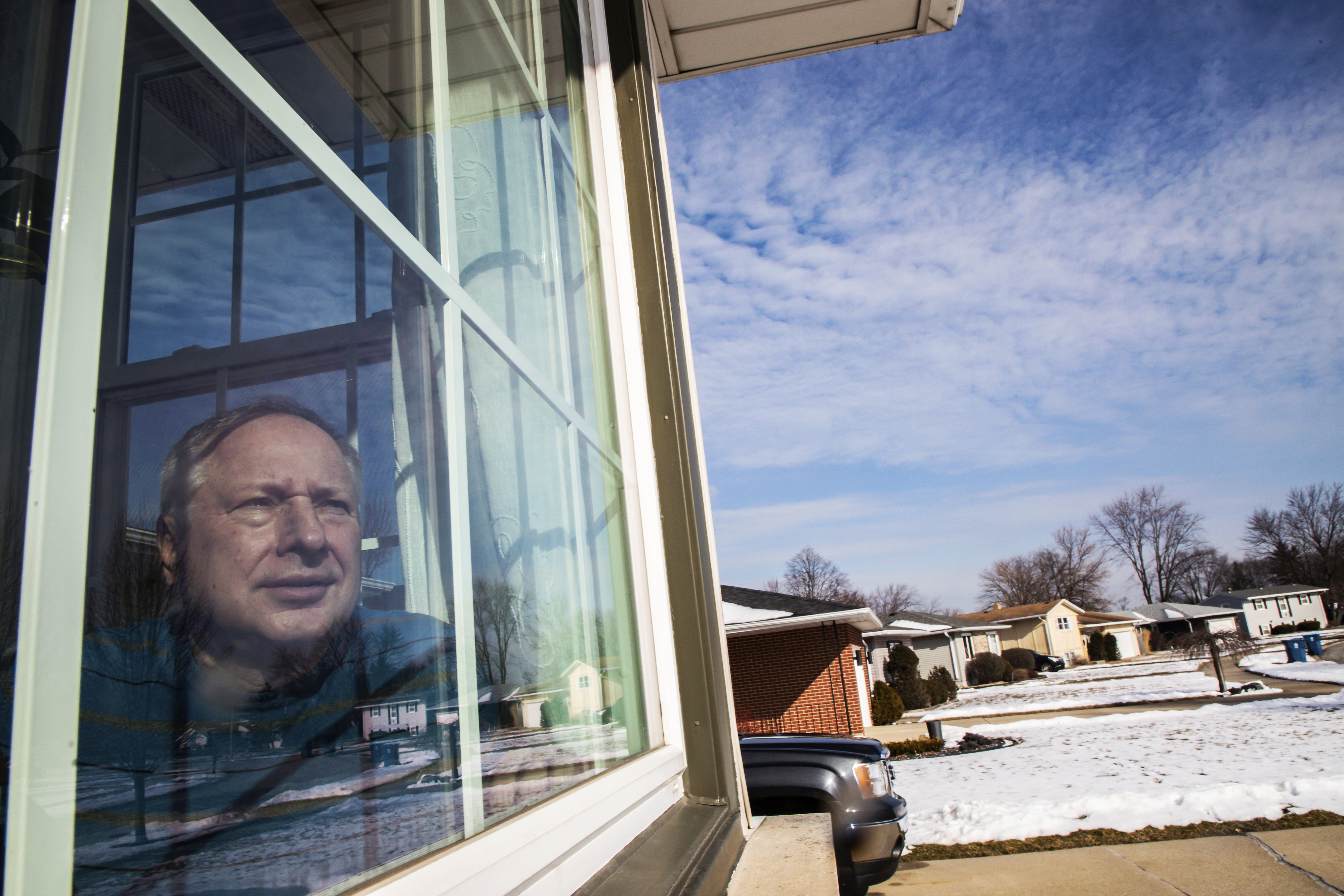In this Feb. 11, 2020, photo, Ken Zurek, 63, poses for a photo at his home in Highland, Ind. Zurek and his wife arrived in China days before news broke of the coronavirus. They cut their trip short because of the virus and decided to self quarantine themselves in their Highland home for 15 days, just as an extra precaution.
