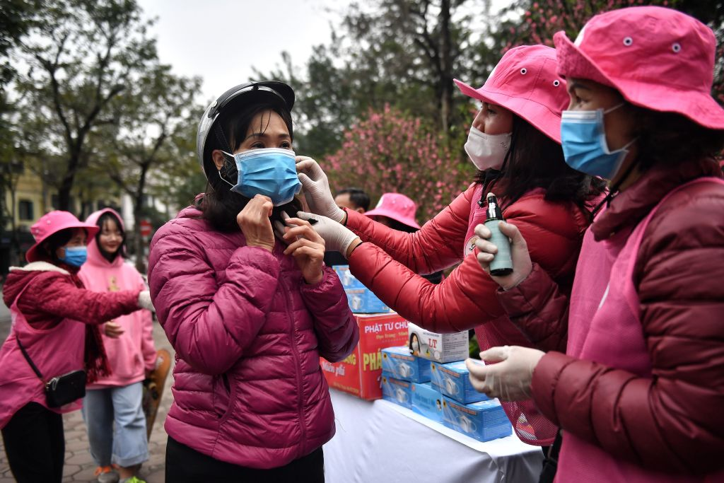 Buddhist volunteers in Hanoi give out free face masks on Feb. 6, 2020, to prevent the spread of 2019-nCoV in Vietnam, which has had eight confirmed cases to date.