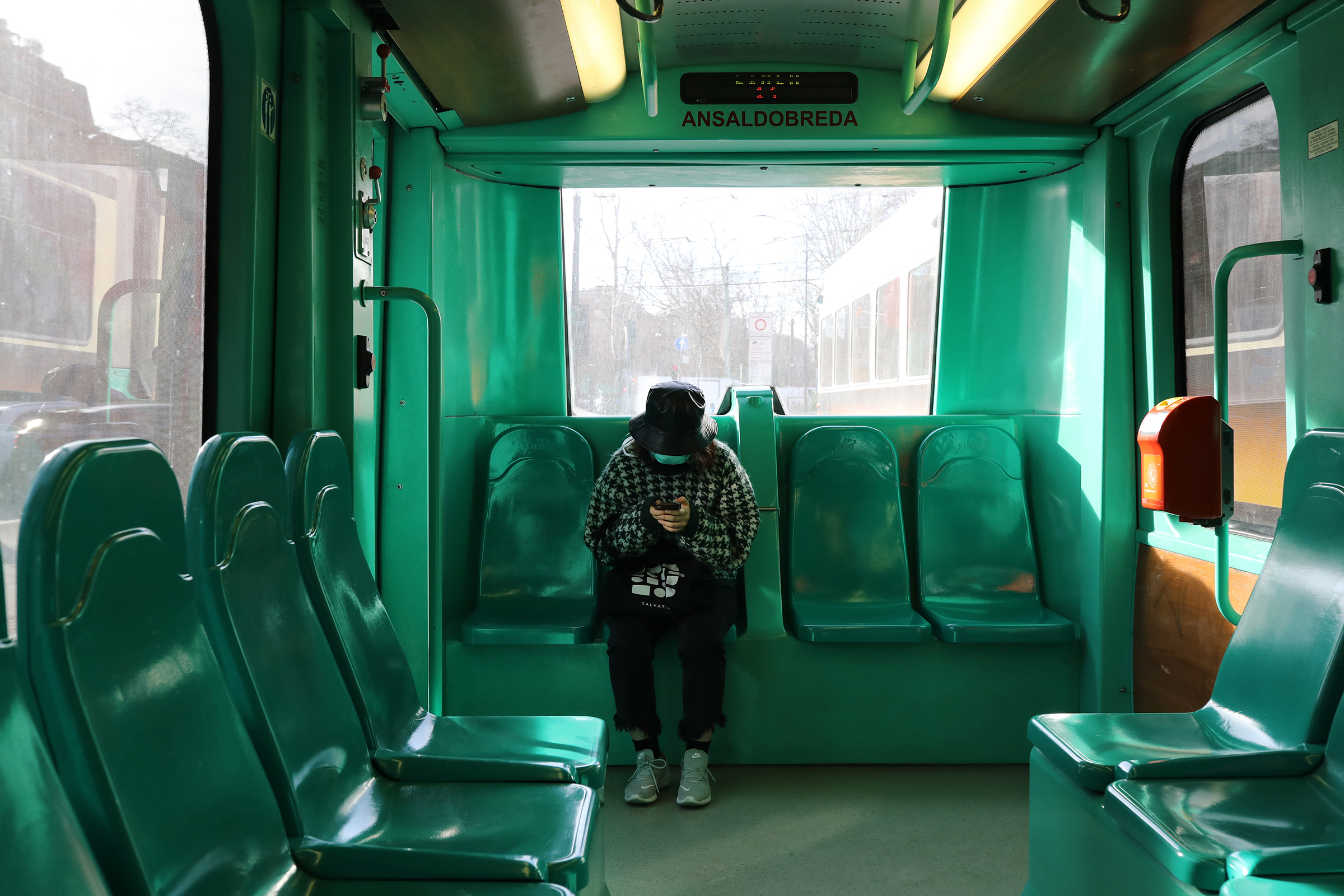 A woman wearing a protective mask is seen taking public transportation on Feb. 27 in Milan, Italy.