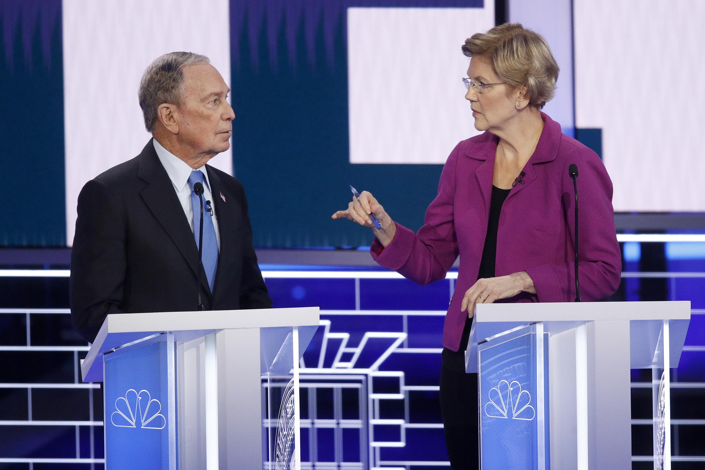 Democratic presidential candidates, former New York City Mayor Mike Bloomberg, left, and Sen. Elizabeth Warren, D-Mass., talk before a Democratic presidential primary debate on Feb. 19, 2020, in Las Vegas.