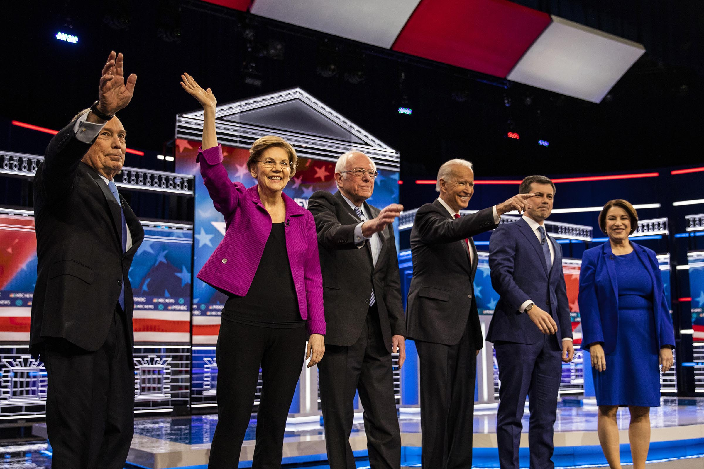 (L-R) Democratic presidential hopefuls Former New York Mayor Mike Bloomberg, Massachusetts Senator Elizabeth Warren, Vermont Senator Bernie Sanders, Former Vice President Joe Biden, Former mayor of South Bend, Indiana, Pete Buttigieg and Indiana Senator Amy Klobuchar arrive on stage for the ninth Democratic primary debate of the 2020 presidential campaign season in Las Vegas on Feb. 19, 2020.
