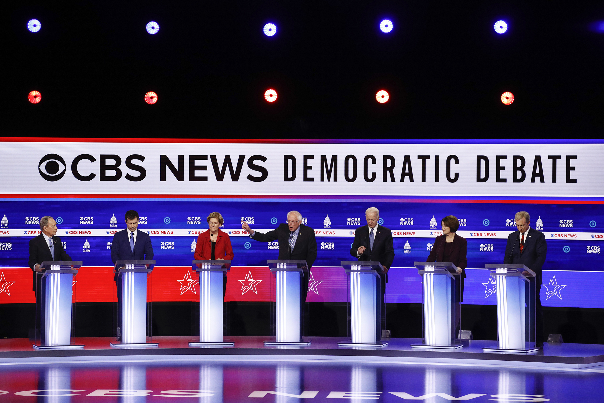 From left, Democratic presidential candidates, former New York City Mayor Mike Bloomberg, former South Bend Mayor Pete Buttigieg, Sen. Elizabeth Warren, D-Mass., Sen. Bernie Sanders, I-Vt., former Vice President Joe Biden, Sen. Amy Klobuchar, D-Minn., and businessman Tom Steyer, participate in a Democratic presidential primary debate at the Gaillard Center, Tuesday, Feb. 25 in Charleston, S.C.