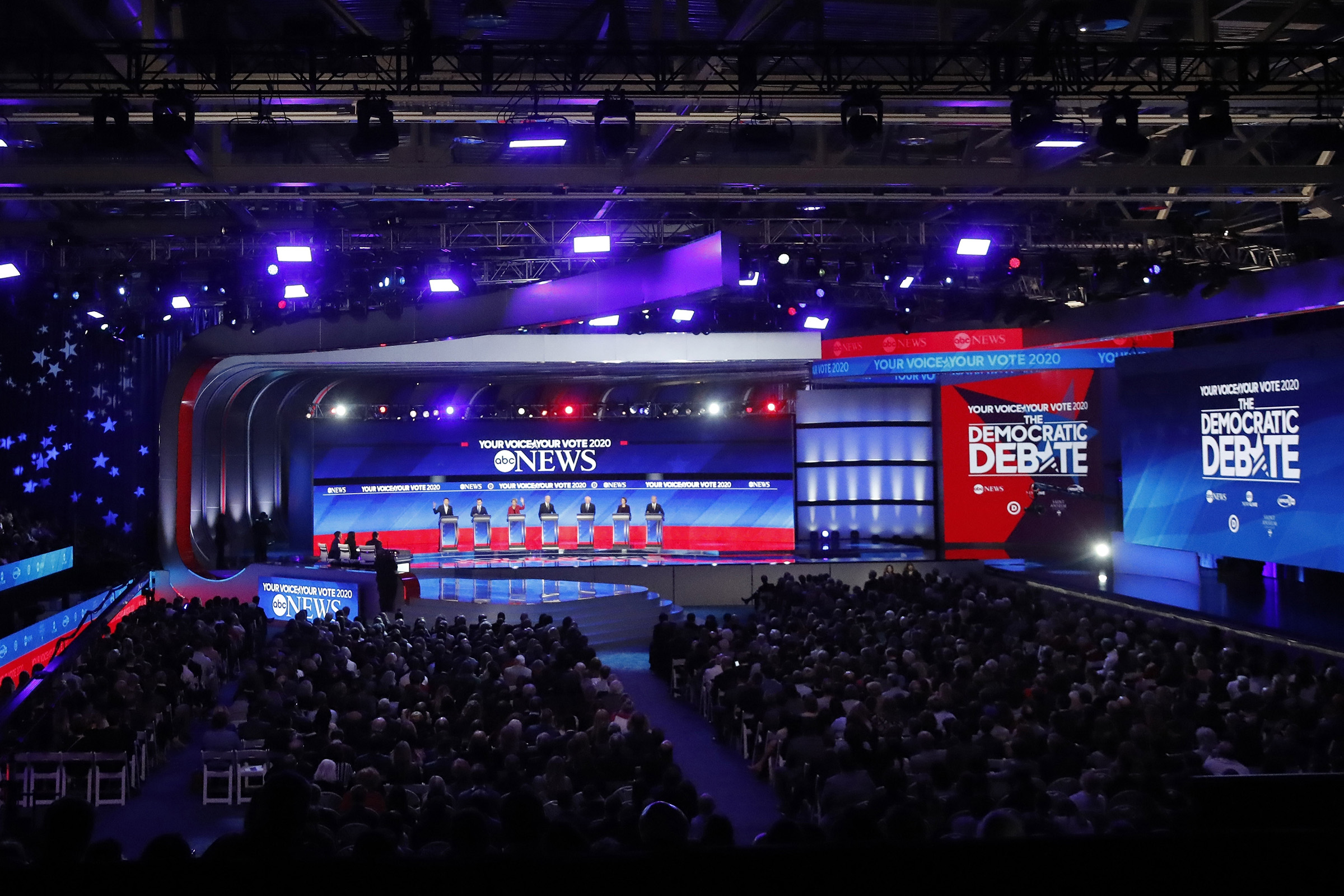 Democratic presidential candidates entrepreneur Andrew Yang, former South Bend Mayor Pete Buttigieg, Sen. Bernie Sanders, former Vice President Joe Biden, Sen. Elizabeth Warren, Sen. Amy Klobuchar, and businessman Tom Steyer participate in a Democratic presidential primary debate in Manchester, N.H. on Feb. 7, 2020.