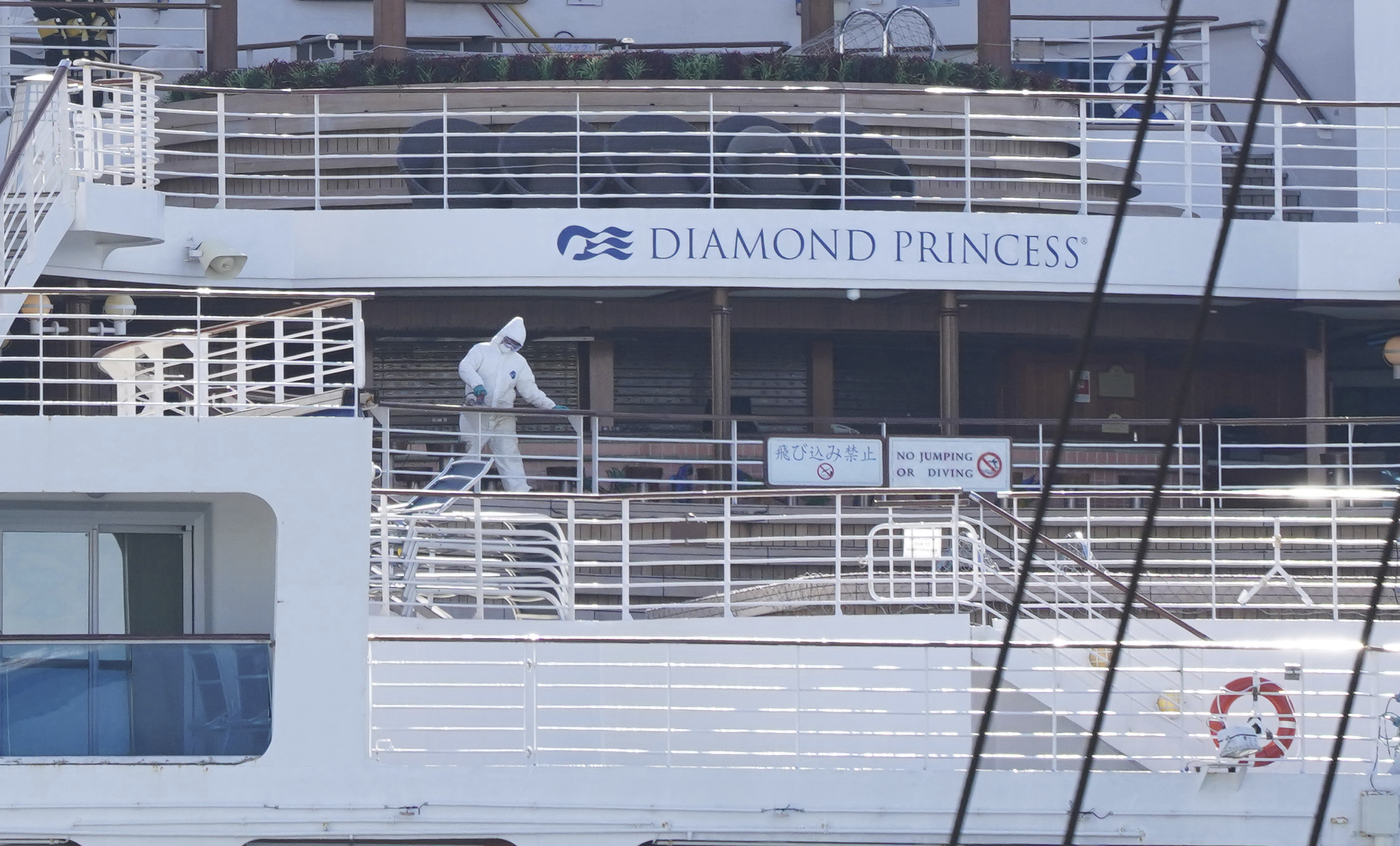 A health worker is seen on the Diamond Princess docked at Daikoku Wharf in Yokohama, Japan, on Feb. 19, 2020.