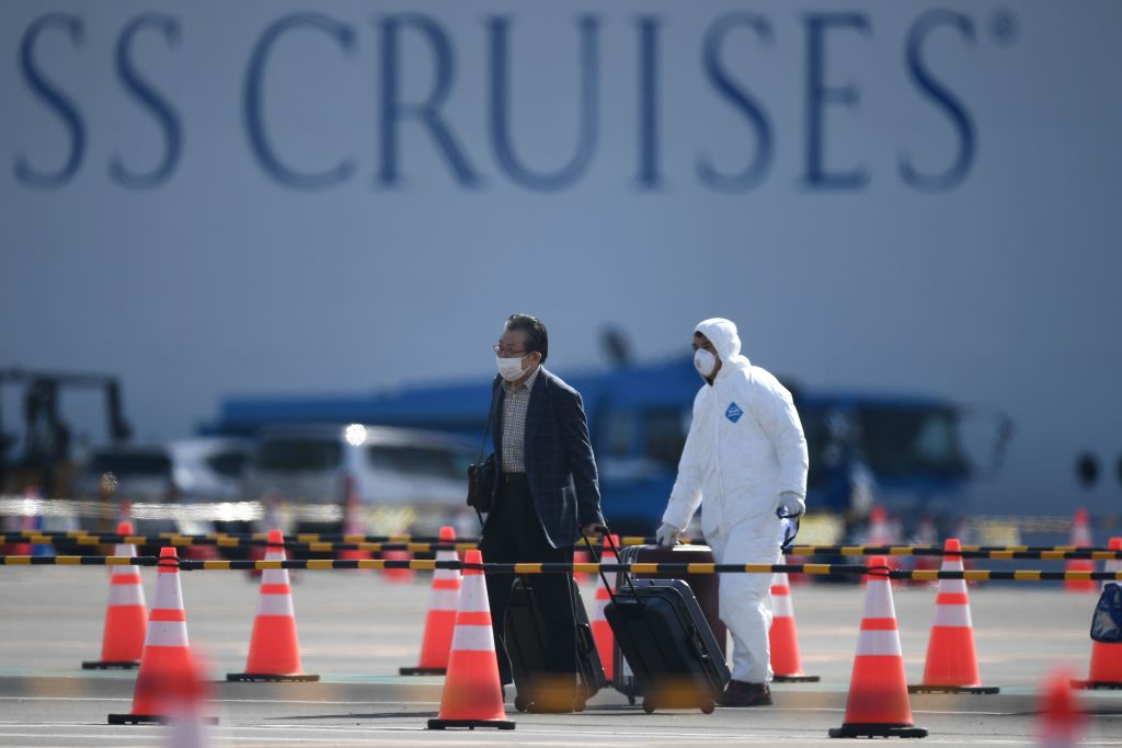 A passenger leaves the Diamond Princess cruise at the Daikoku Pier Cruise Terminal in Yokohama, Japan, on Feb. 19, 2020.