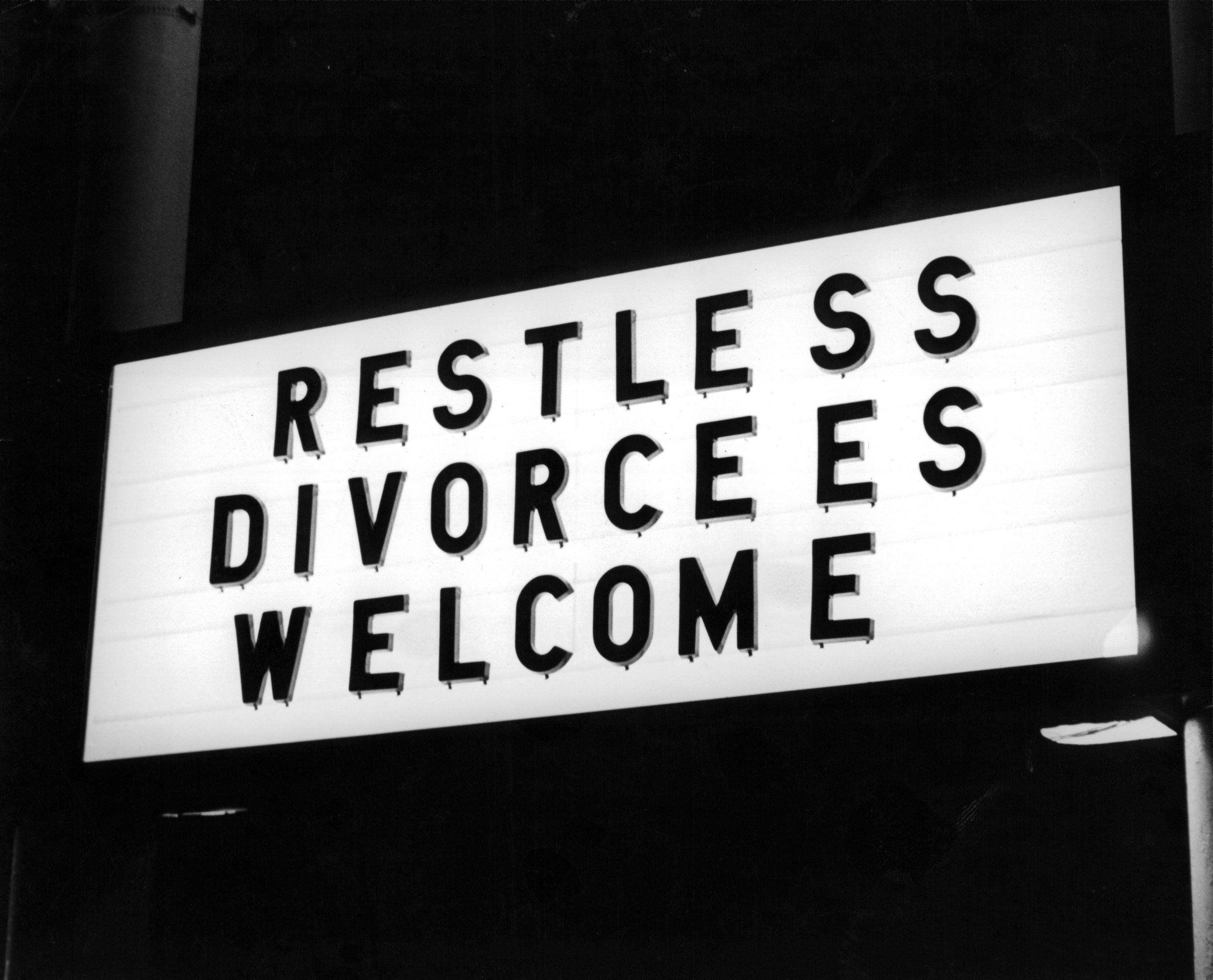 A view of a hotel sign in Reno, Nev., famous for speedy divorces. Circa 1940.