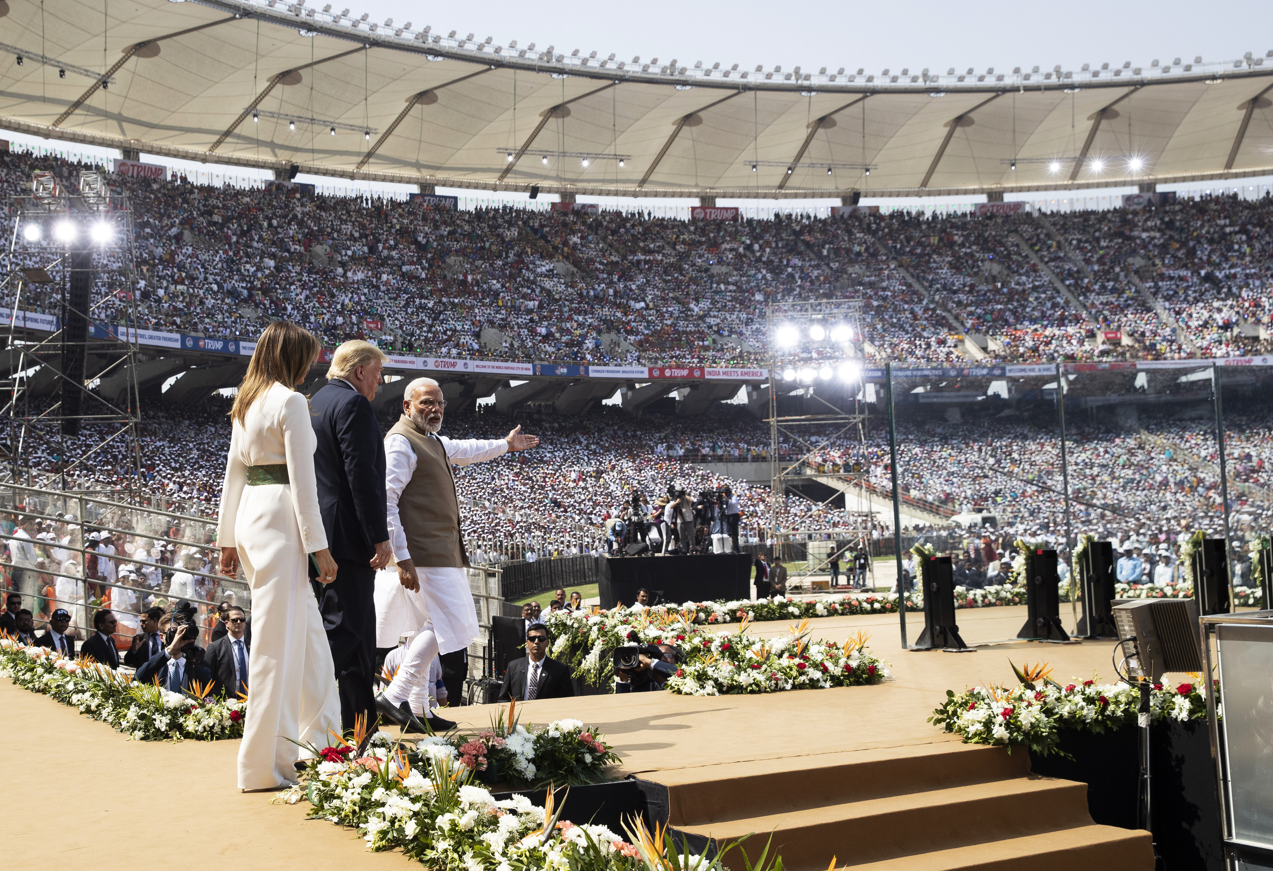 U.S. President Donald Trump, first lady Melania Trump, and Indian Prime Minister Narendra Modi arrive for a  Namaste Trump,  event at Sardar Patel Stadium, Monday, Feb. 24, 2020, in Ahmedabad, India.