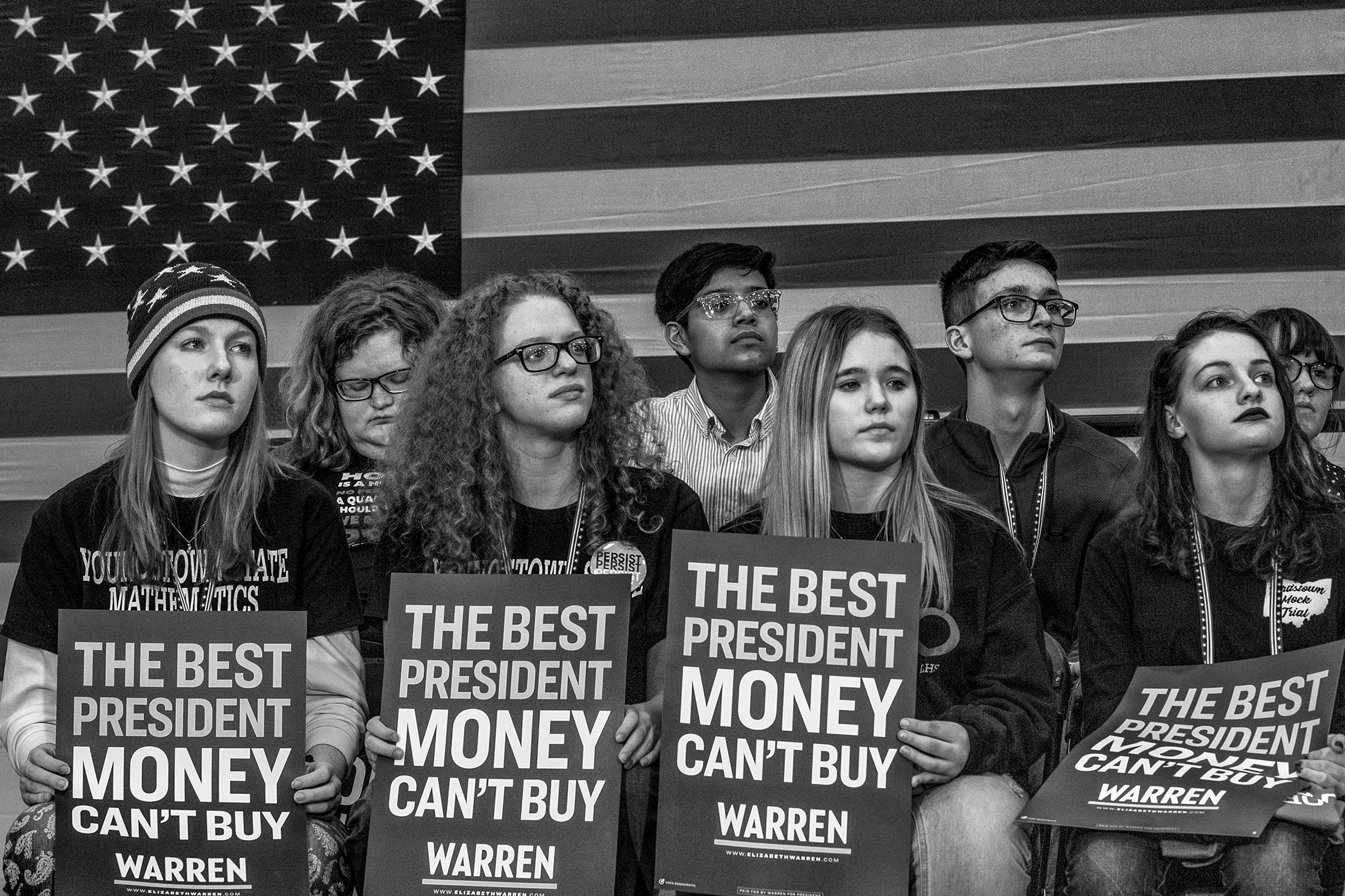 Supporters of Elizabeth Warren listen as she gives a speech at the Get Out the Caucus Rally in Iowa City, Iowa.