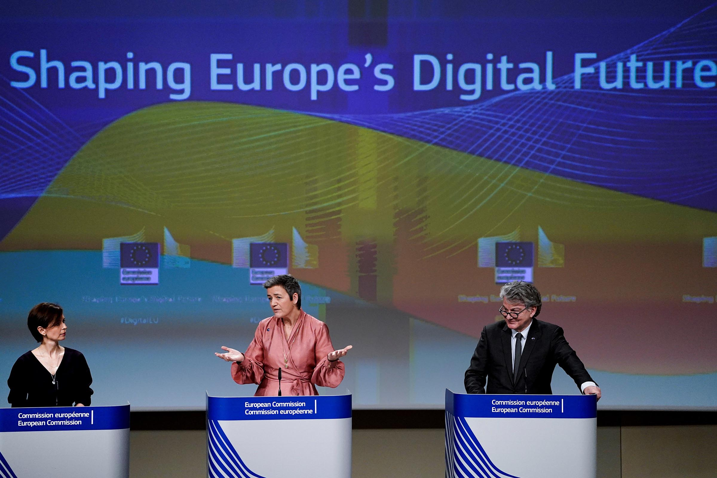 European Commission Executive Vice-President Margrethe Vestager  (C) and EU Commissioner for Internal Market Thierry Breton (R) give a press conference on Artificial Intelligence (AI) on Feb. 19, 2020 at the European Commission headquarters in Brussels.