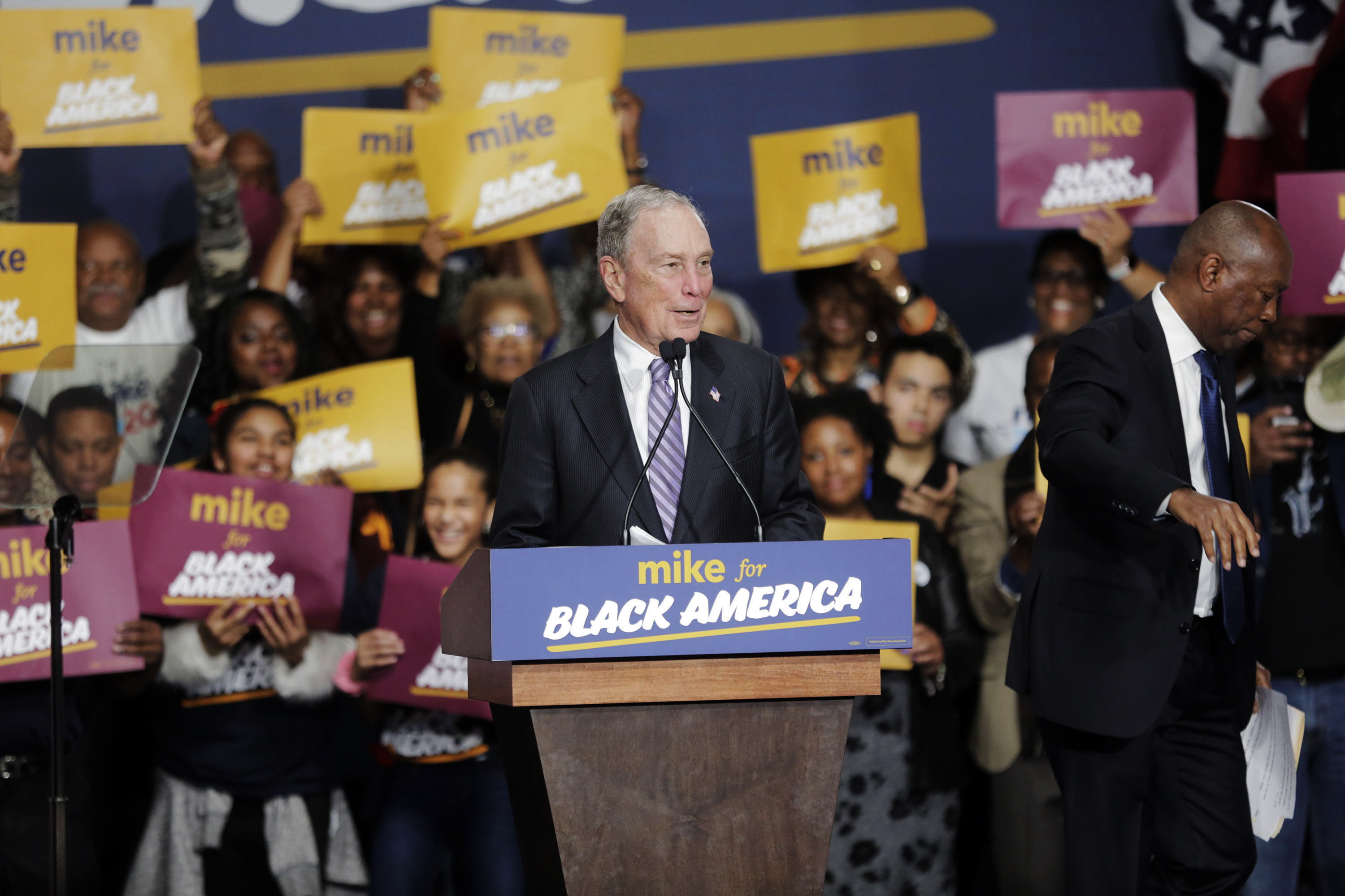 Democratic presidential candidate and former New York City Mayor Michael Bloomberg speaks during a campaign rally at the Buffalo Soldier Museum in Houston, Thursday, Feb. 13, 2020. Houston Mayor Sylvester Turner stands at right.