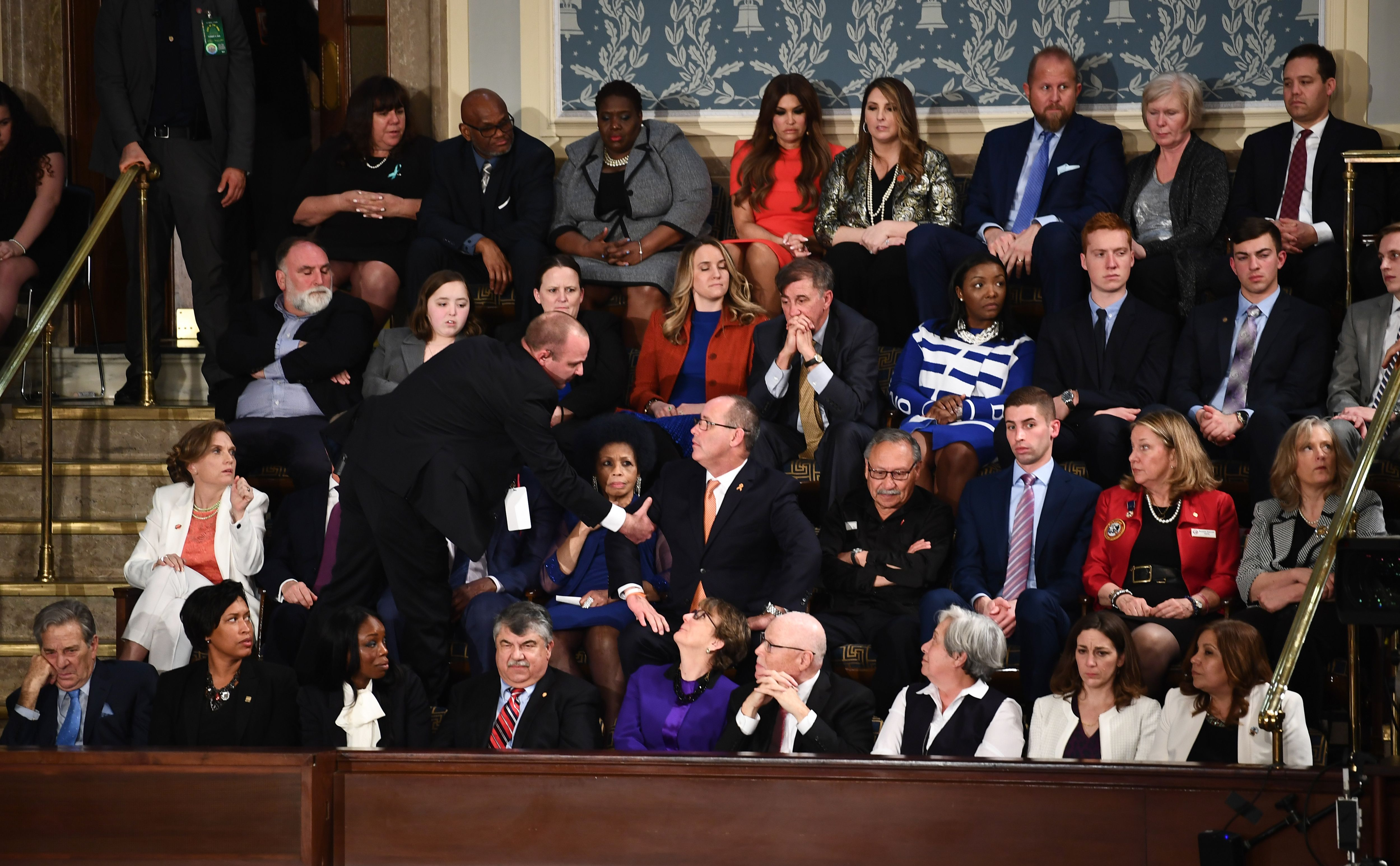 Fred Guttenberg is removed by security after yelling as President Trump delivered the State of the Union address at the US Capitol in Washington, D.C on Feb. 4, 2020.