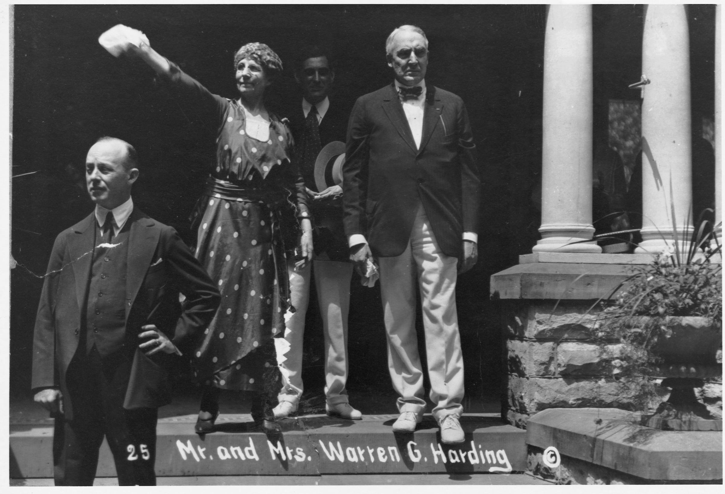 Warren G. Harding and his wife Florence on the front porch of the Harding house in Marion, Ohio, from which Harding conducted his successful campaign for the Presidency.