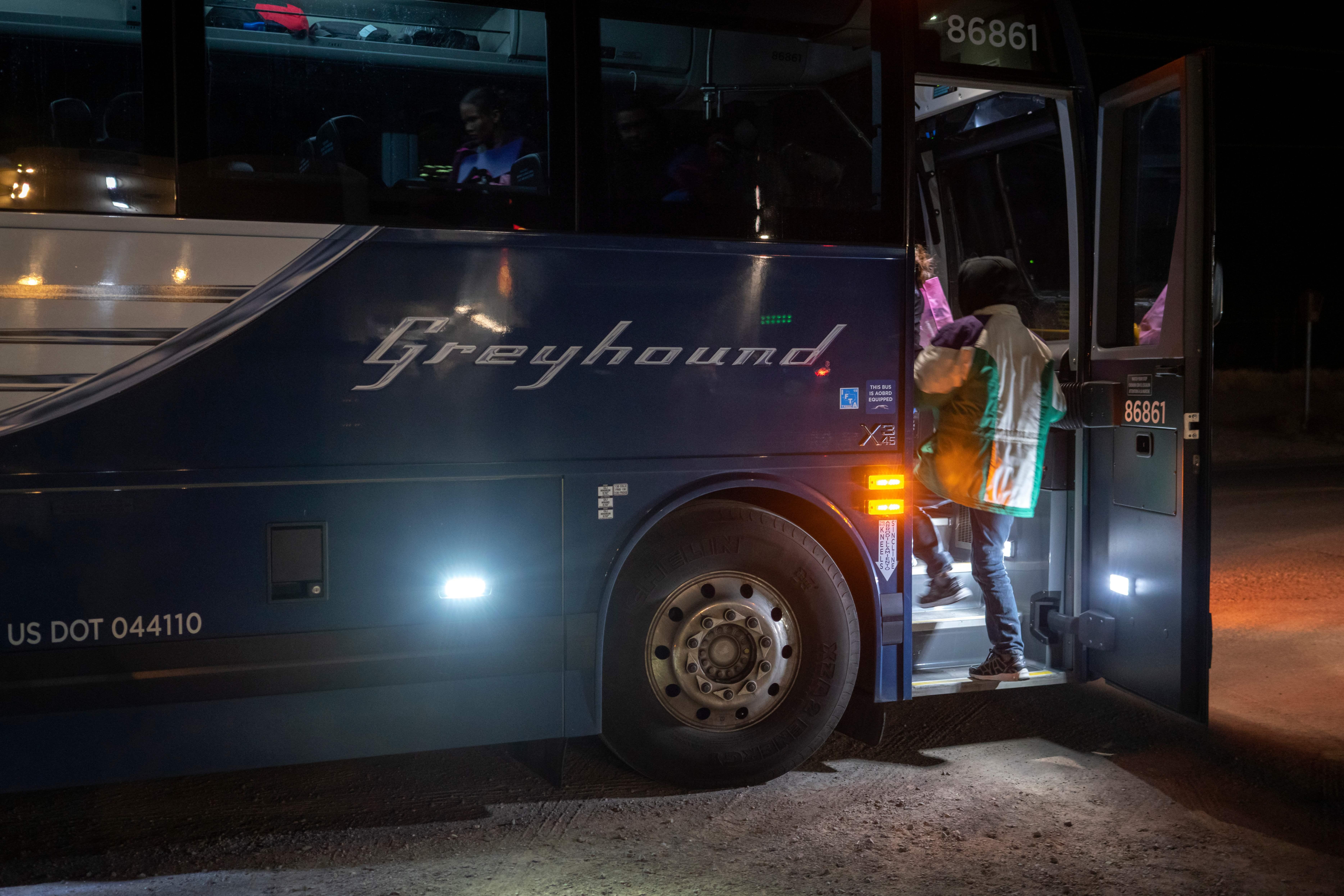 Passengers board a Greyhound bus on Jan. 3, 2019.