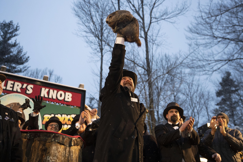 Groundhog Club co-handler Al Dereume holds Punxsutawney Phil, the weather prognosticating groundhog, during the 134th celebration of Groundhog Day on Gobbler's Knob in Punxsutawney, Pa., on Feb. 2, 2020.