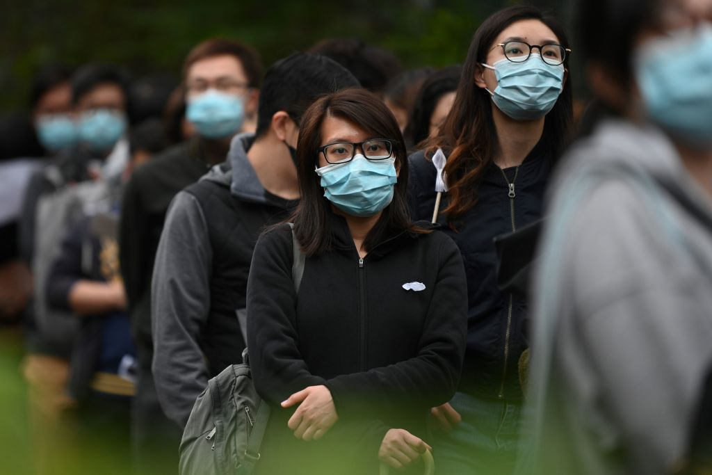 Hong Kong medical workers line up to submit a petition to the city's Hospital Authority in support of a calls for the full closure of the border with mainland China, on Feb. 4, 2020.